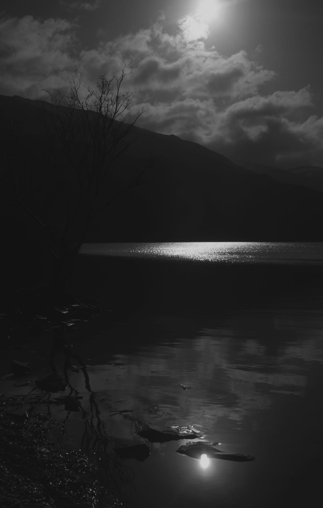 Sunrise over water. by hefin.owen