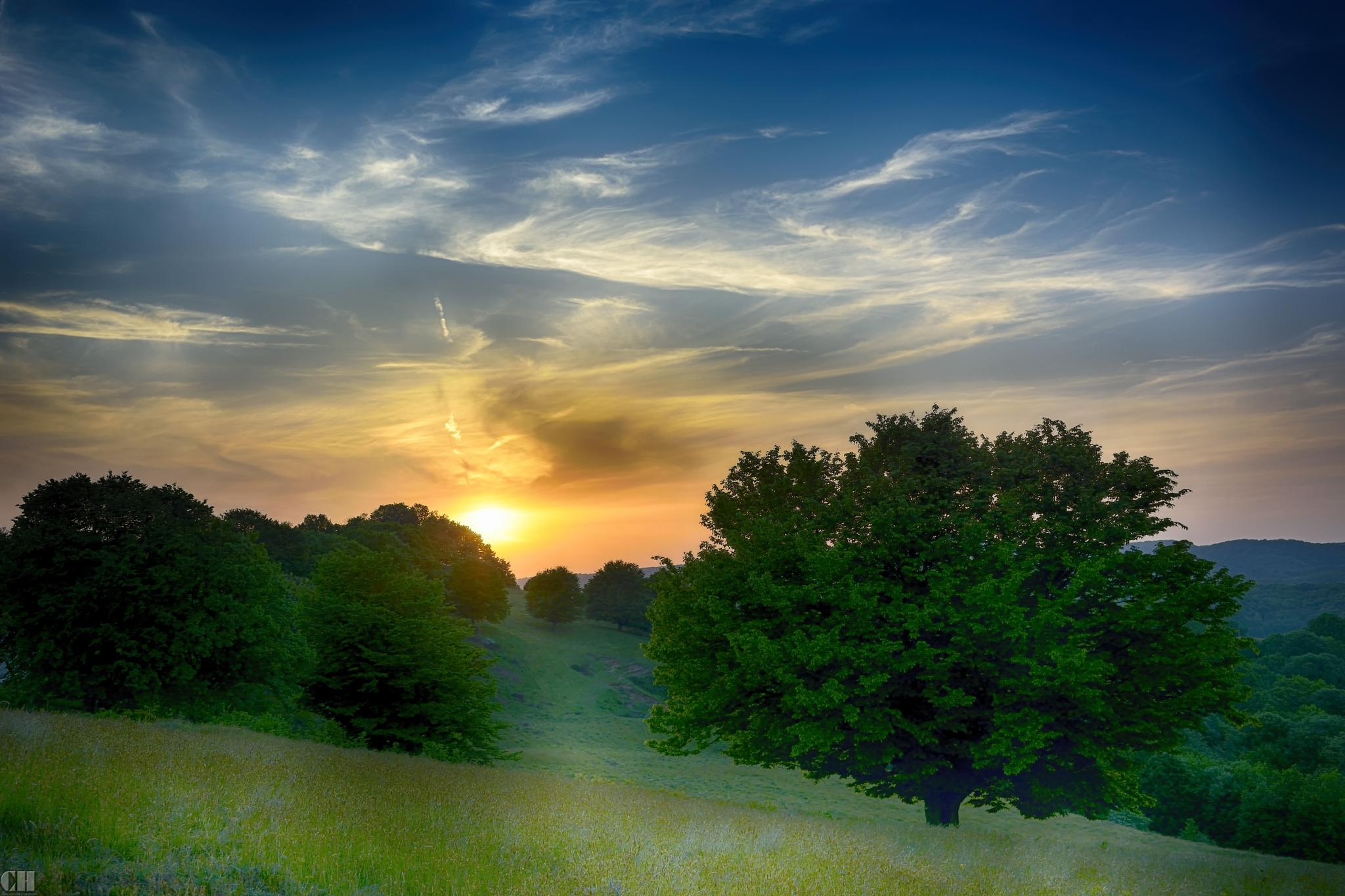 sunset on hills by constantin.hurghea