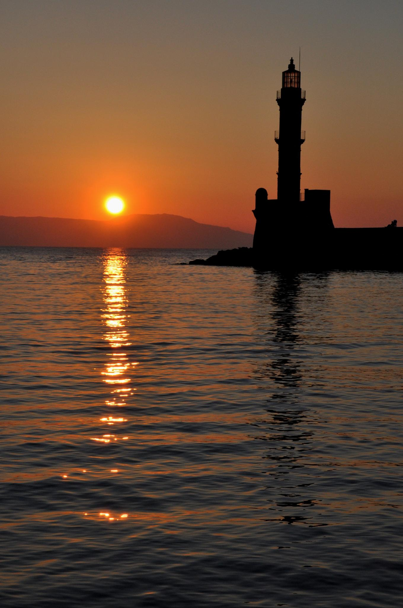 Chania - lighthouse at sunset by stefano.baldan