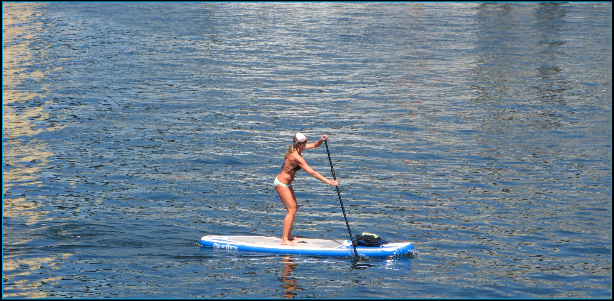 Paddle boarding by Philippines the beautiful
