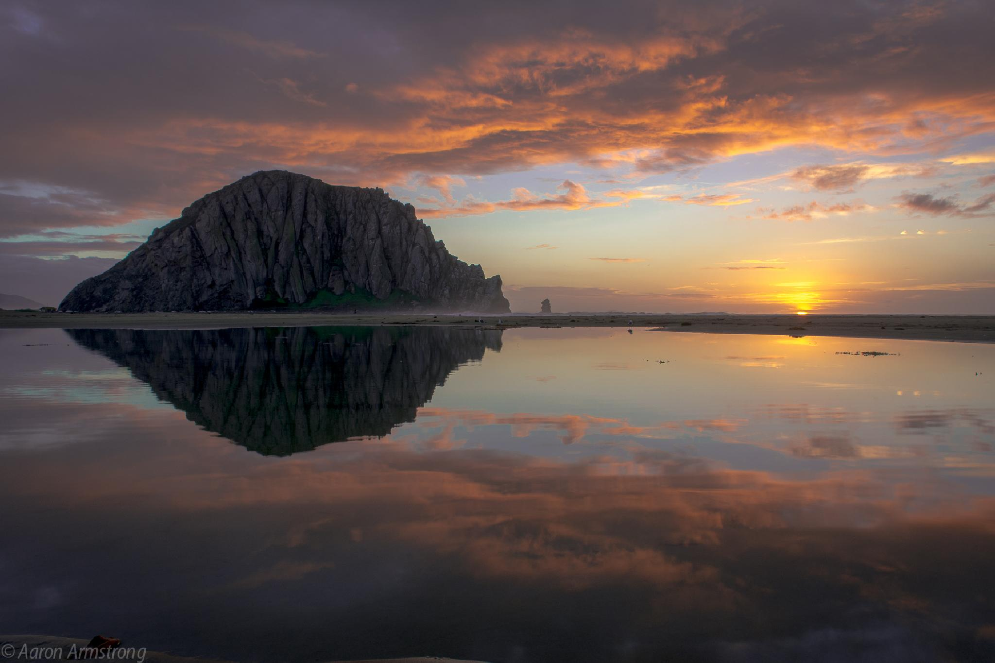 Sunset reflection at Morro Rock by aaron.armstrong.336