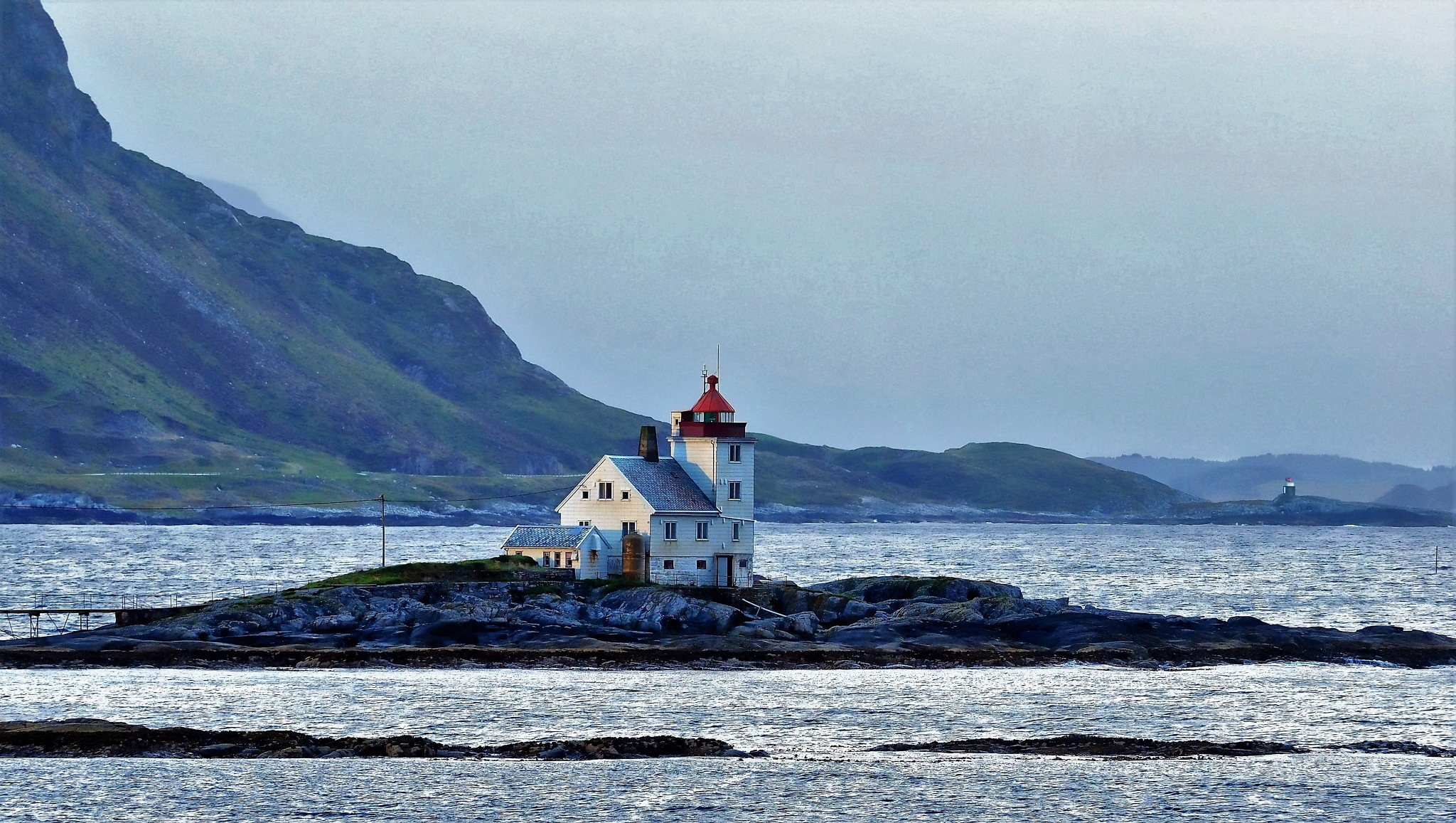 Lighthouse on coastal Norway by william.l.bosley