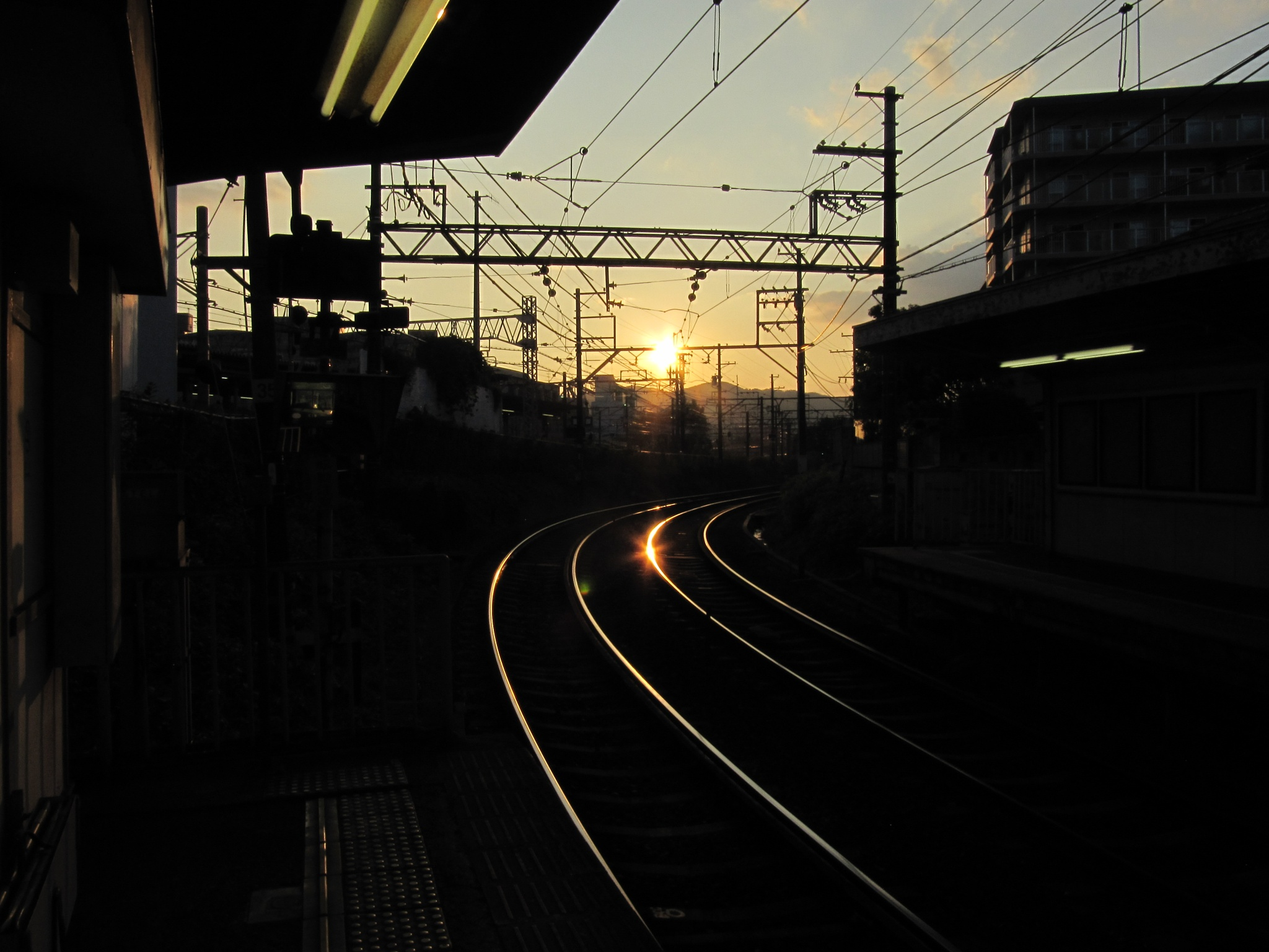 Sunset is reflected in rail by SANRI