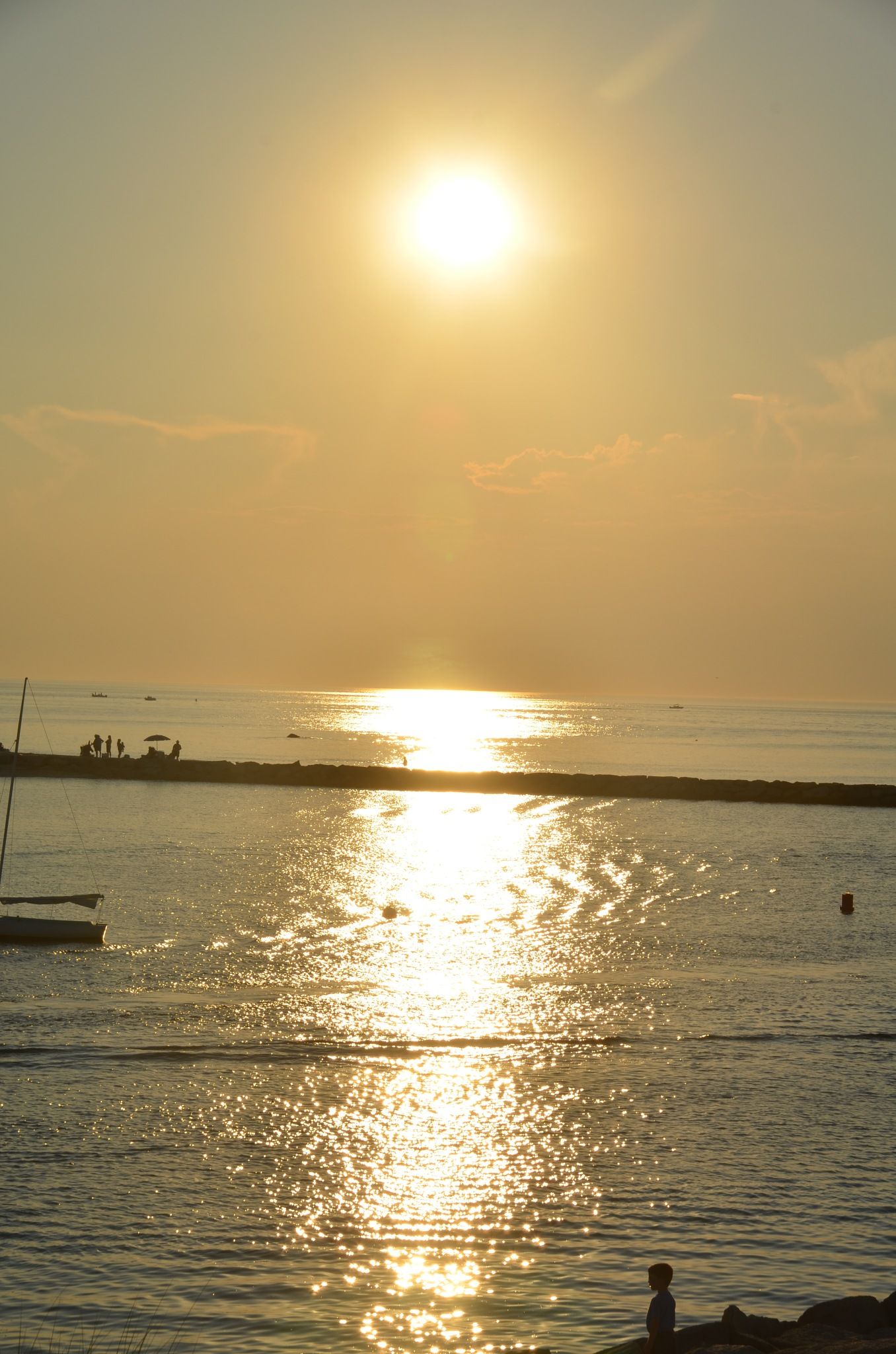 Sun set  ~     wicked  yellow  reflecting  off  Cape Cod Bay  and the entrance to Sesuit  Harbor     by domenic.silvi