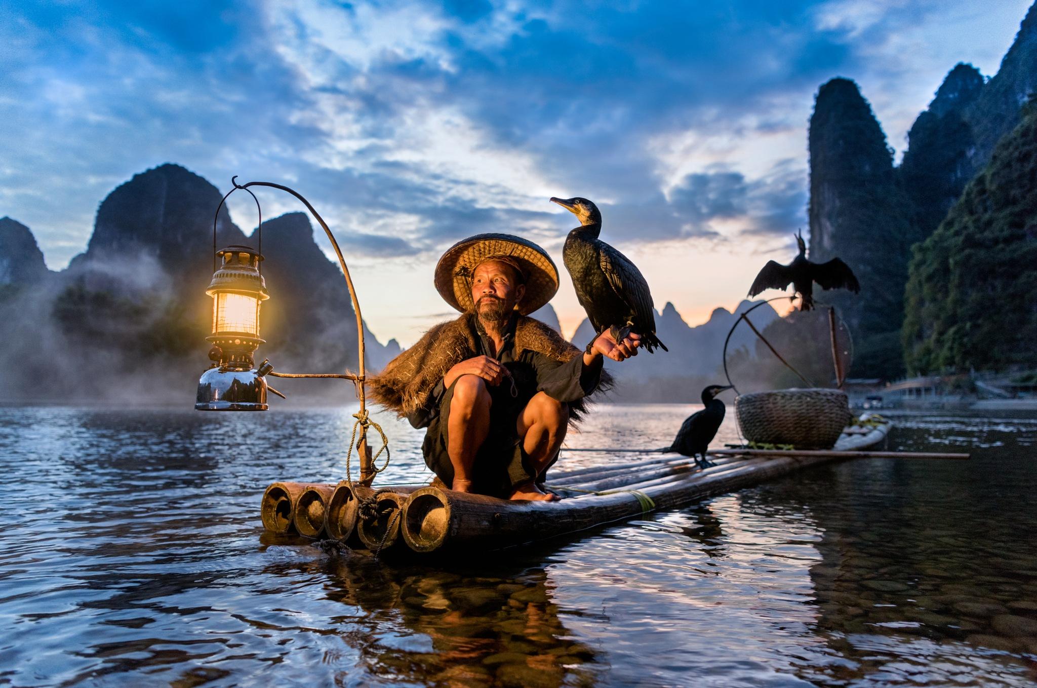 The Cormorant Fisherman by Robdigphot