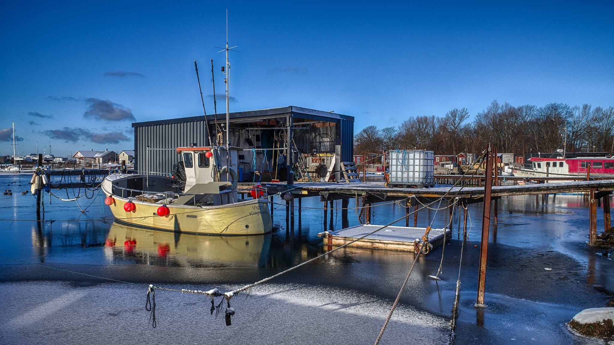 a sunny day in the fishing port by Anders Borglin