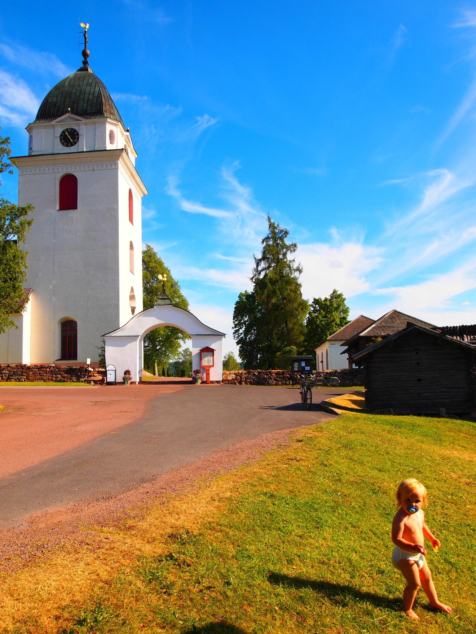 Baby outside church by synovemaria.borlaugdufva