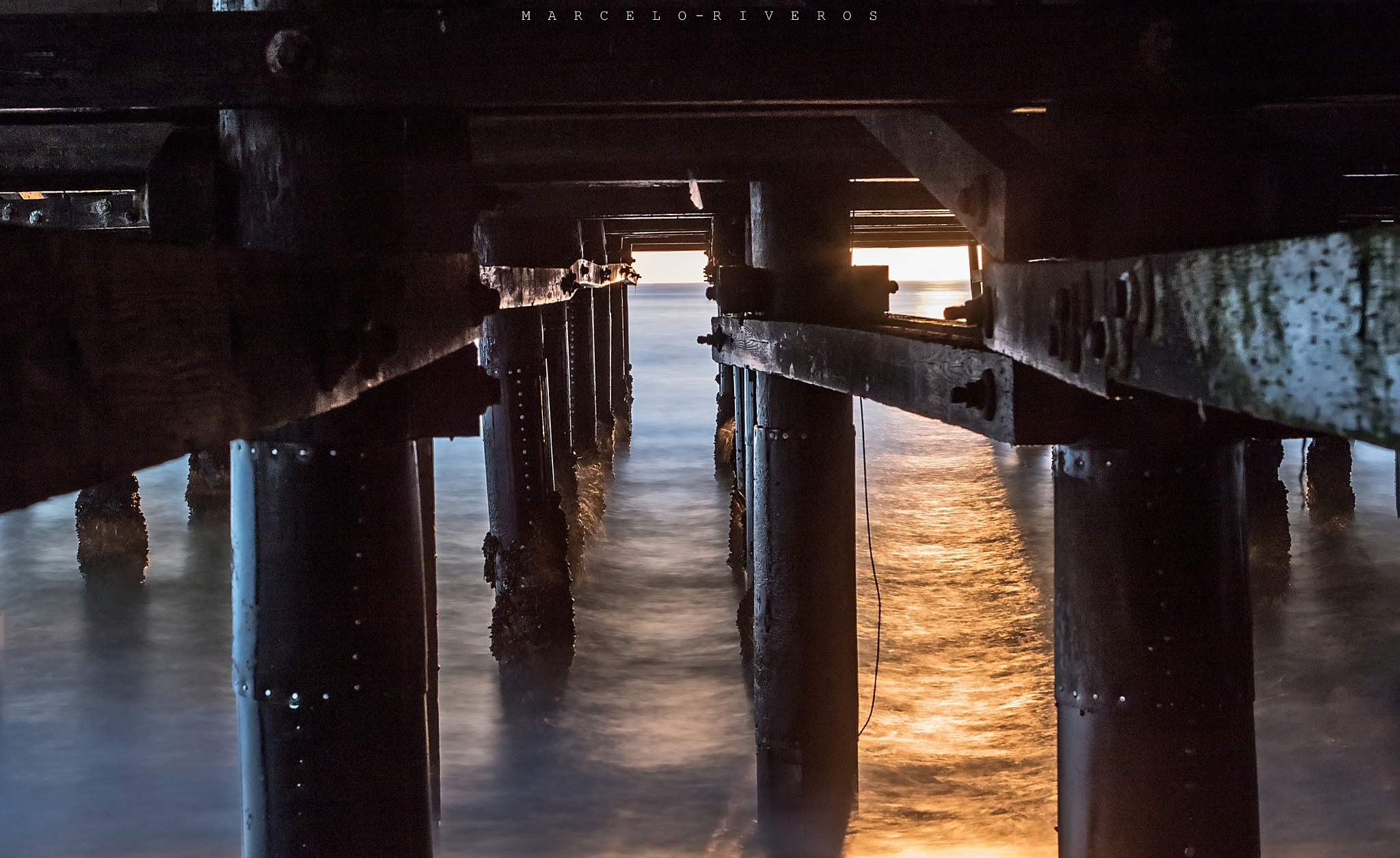 Underneath the Pier by Marcelo Riveros