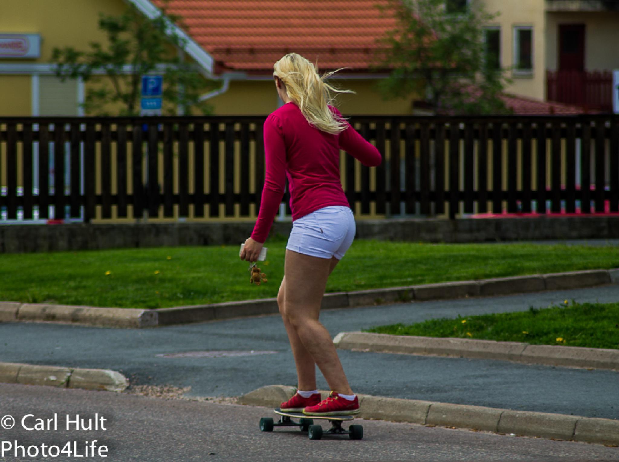 Girl on skateboard by Carl Hult