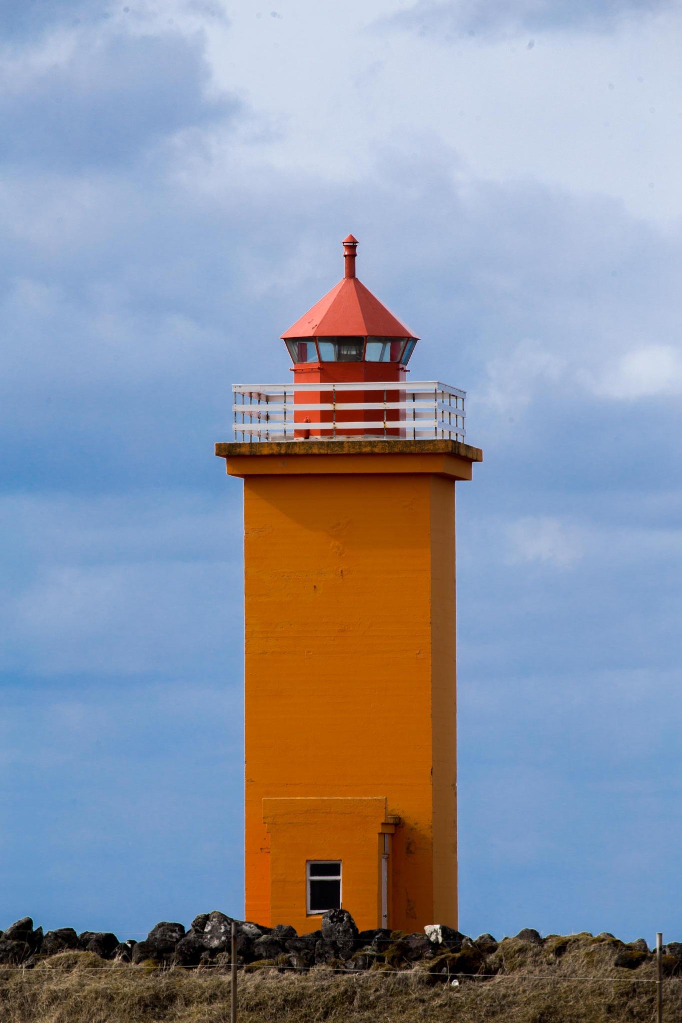 Orange Lighthouse by charles desrosiers