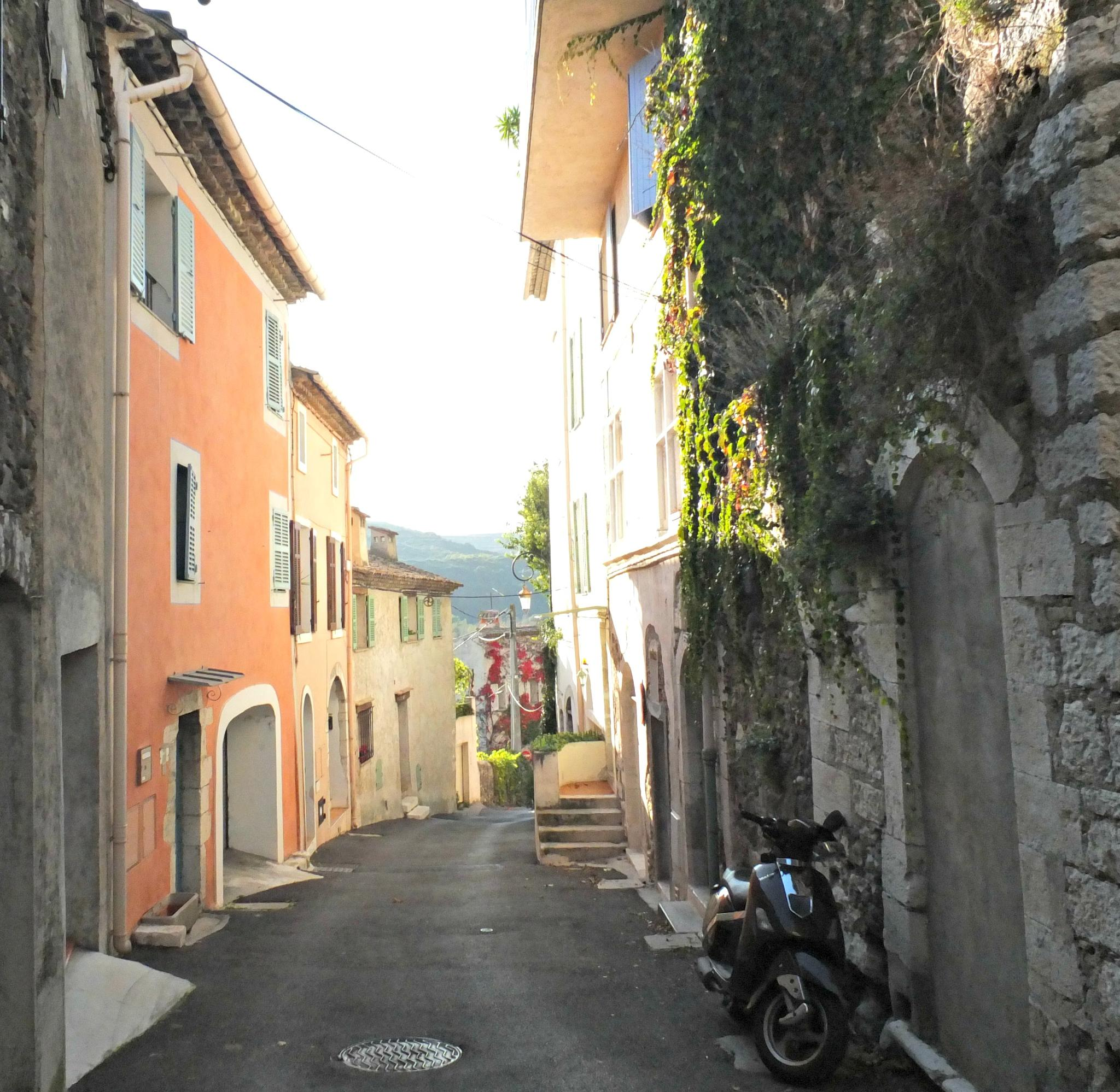 Hilly village street by Cora