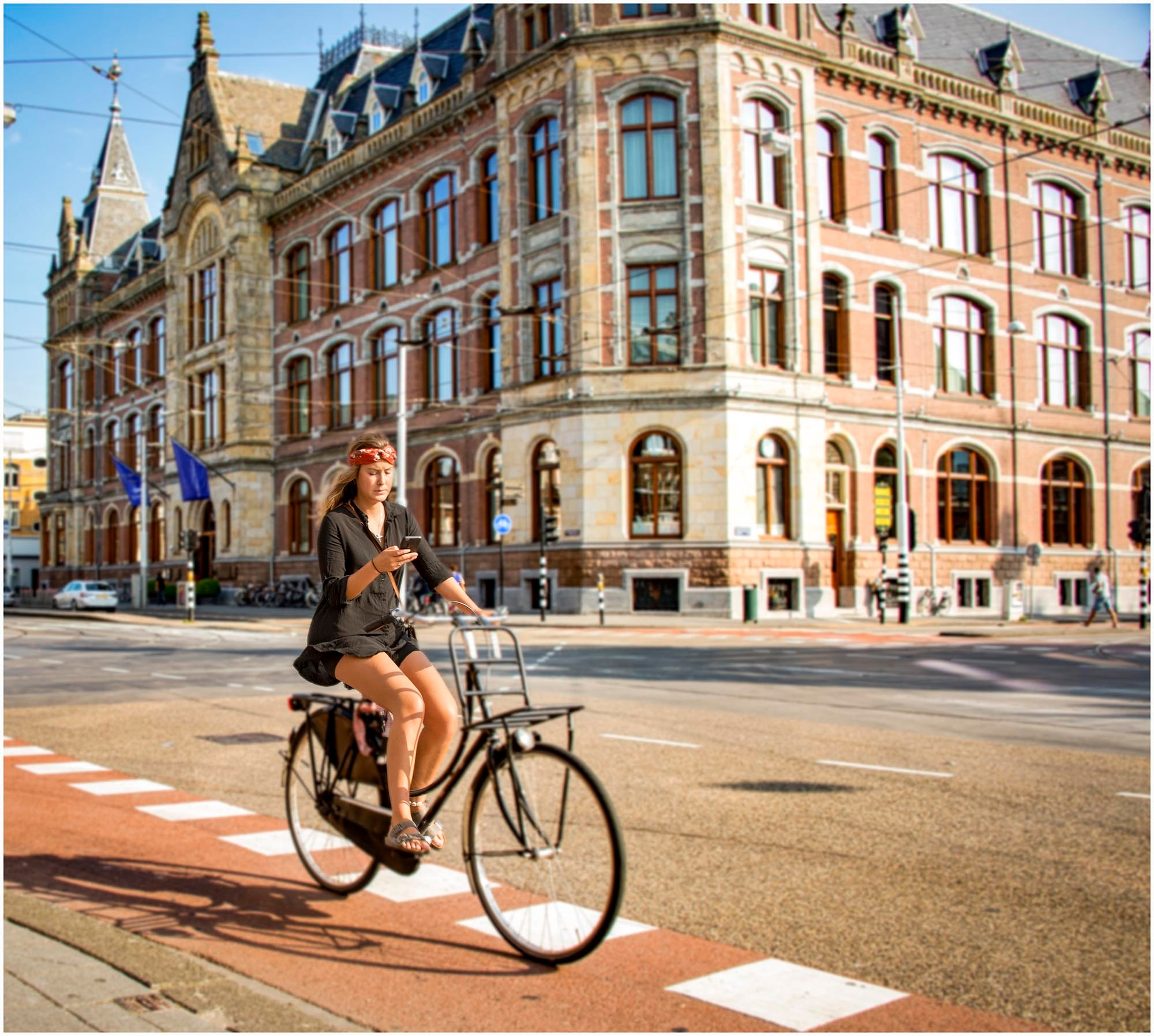 Girl on Bike - Amsterdam by tedurquhart1