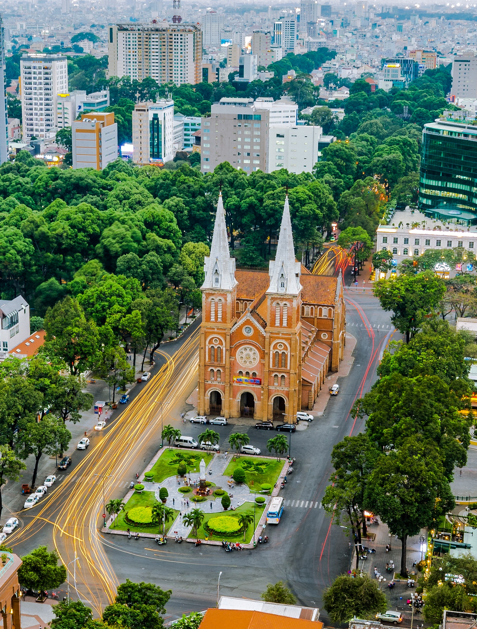 Notre Dame cathedral is in this picture, yellow trail on street. by Alex Pham