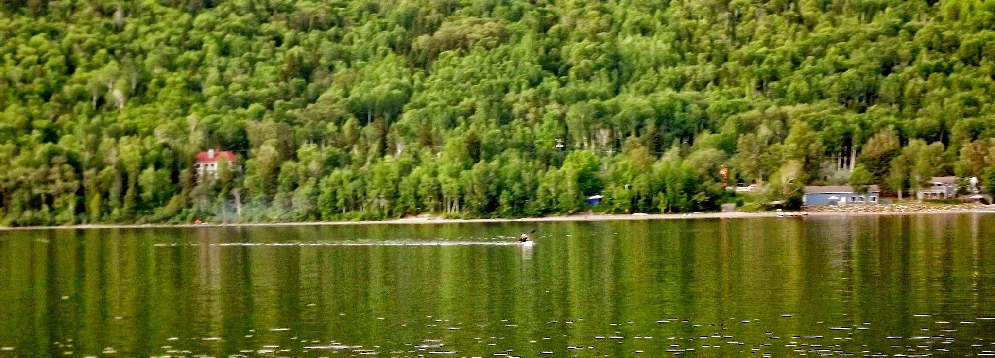 Kayak rider on the lake by real.michaud.5036