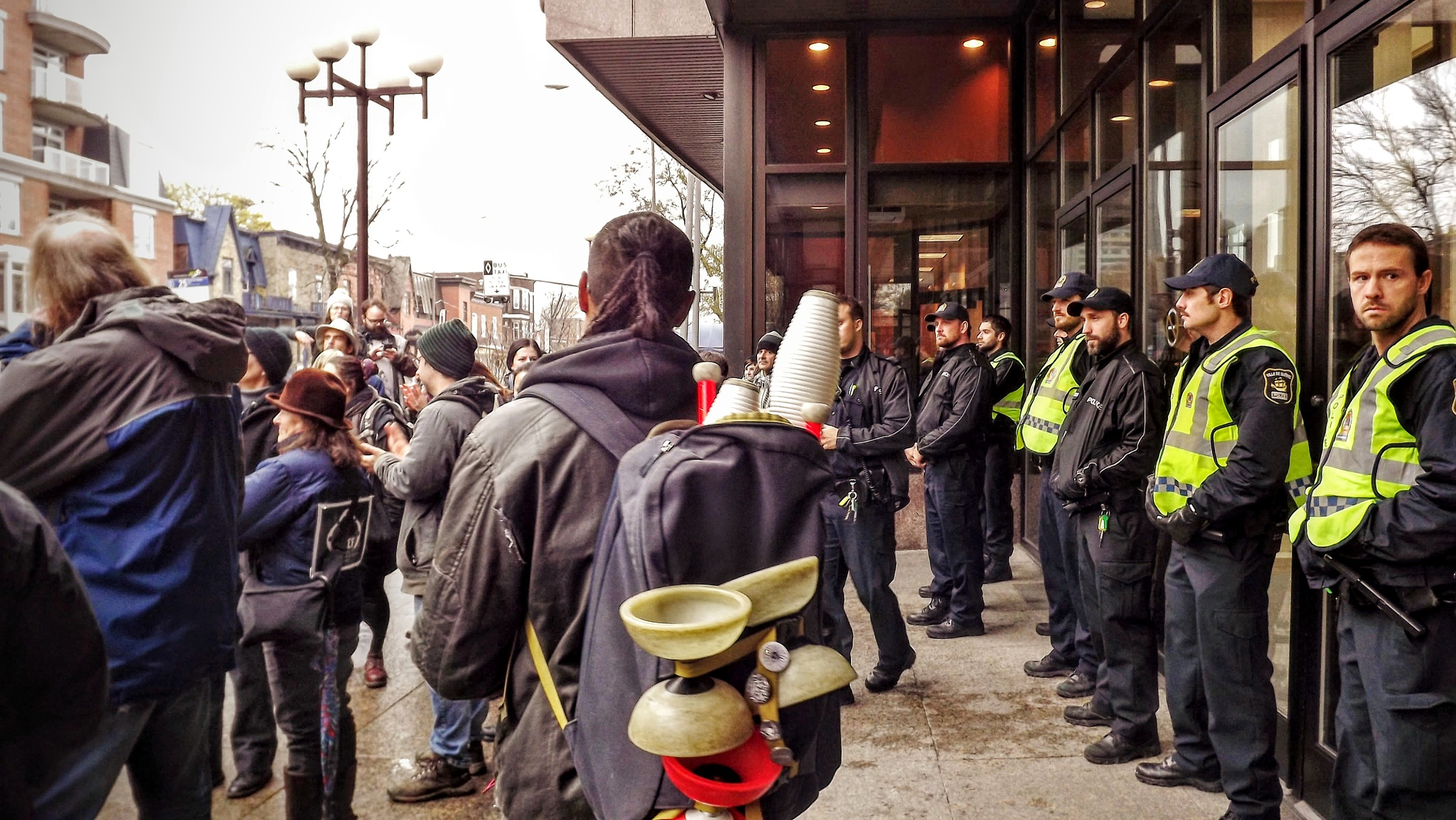 Cops keep the bank & manifesters keep freedom by real.michaud.5036