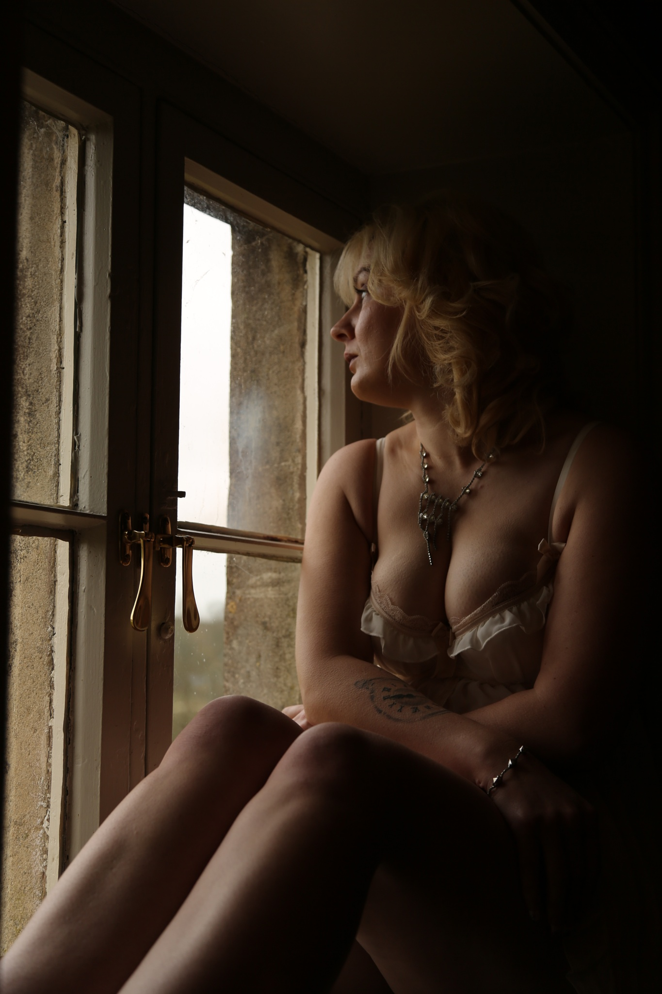 Pamela in the window by               JWPhotography