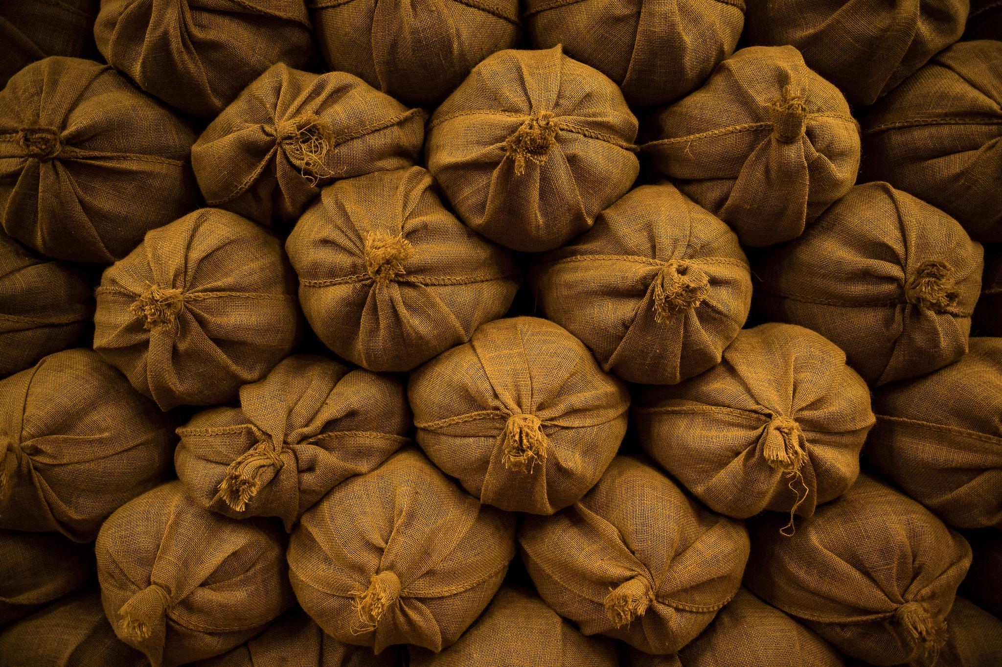 Stacks of grain bags by Kai Kim