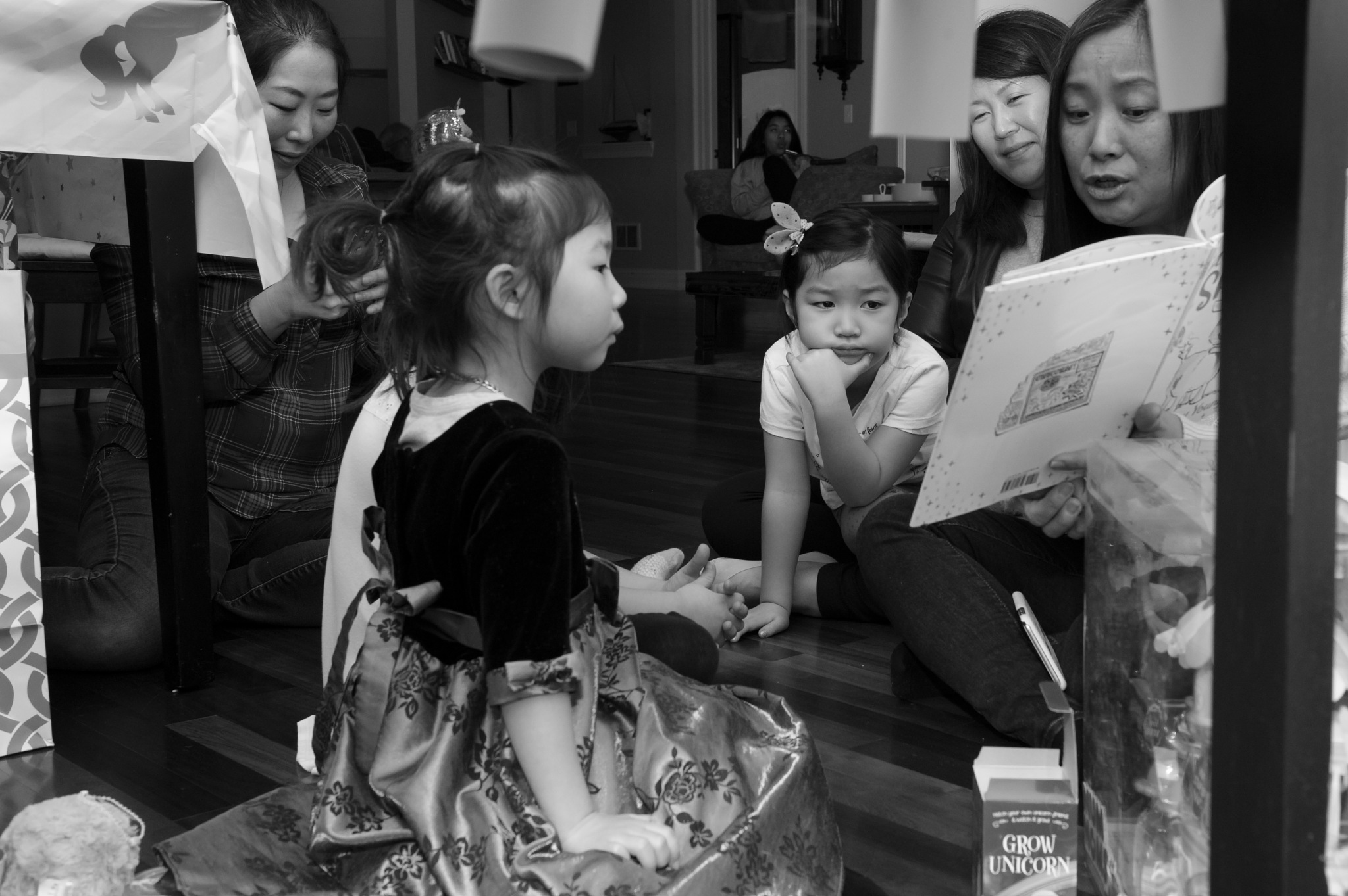 Photo in Family #kid #listen #reading #book #b&w #together #story time