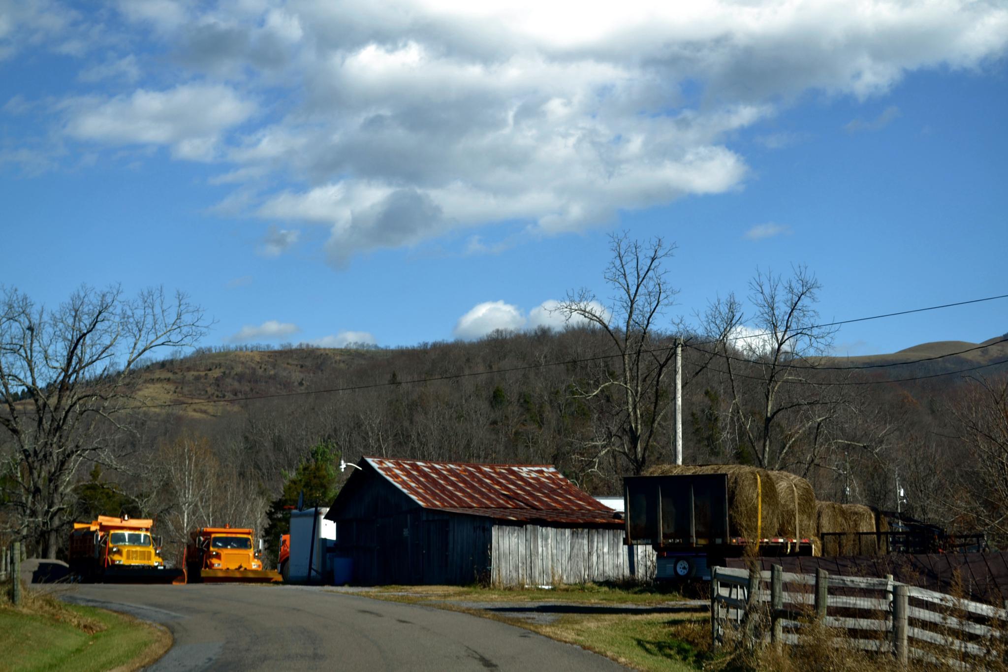Barn, Hay and Trucks by lindandarrell