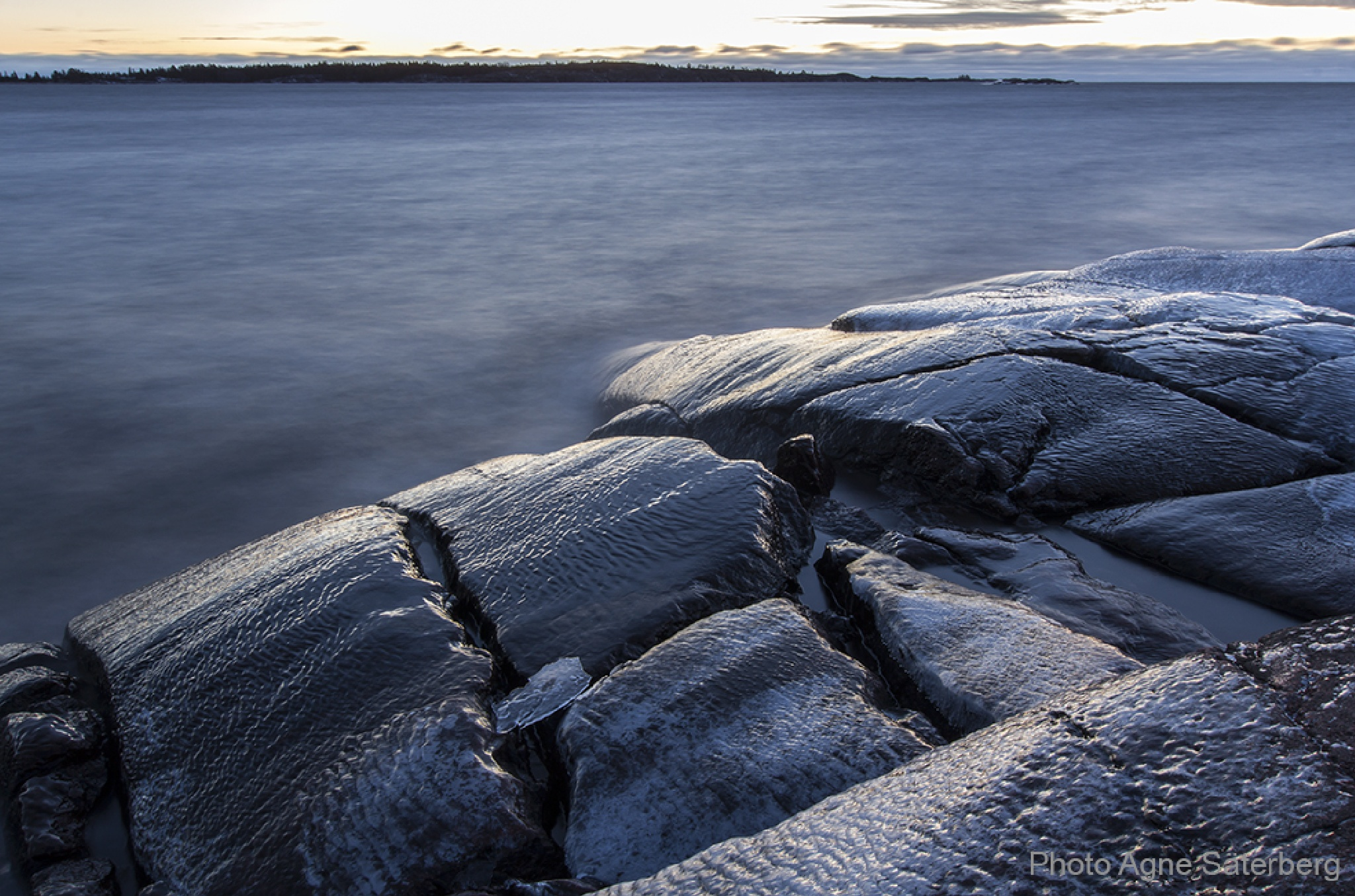 Ice on the rocks at the coast by Agne Säterberg