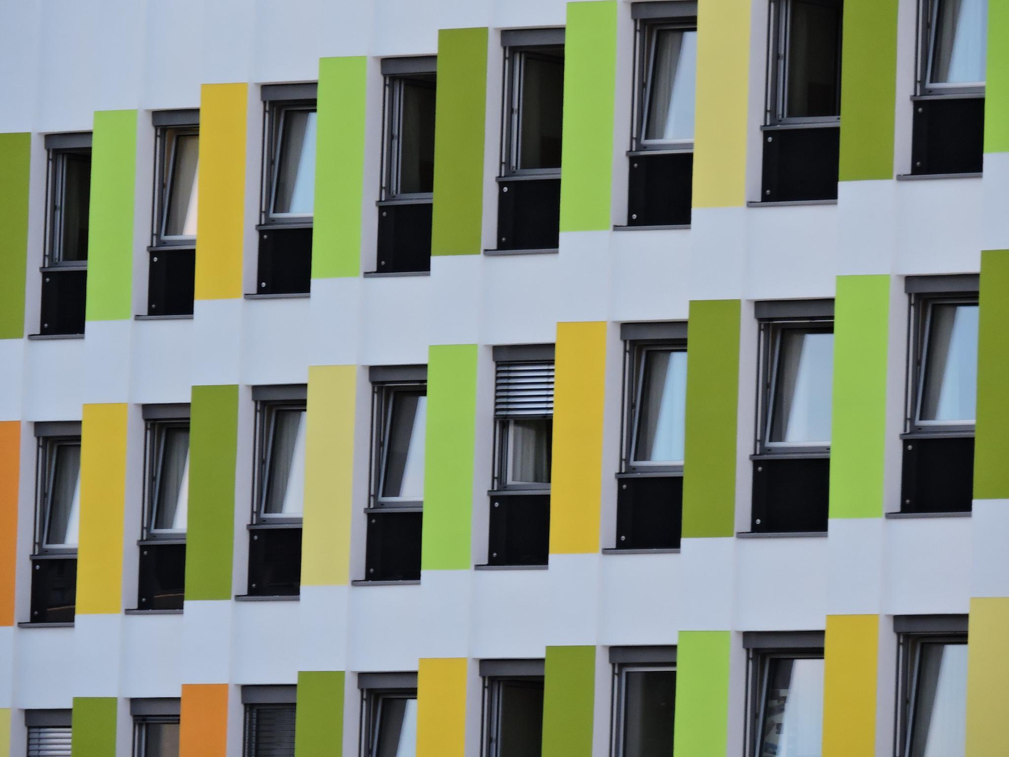 Colorful Fassade of a modern hospital. by Oliver Brecht