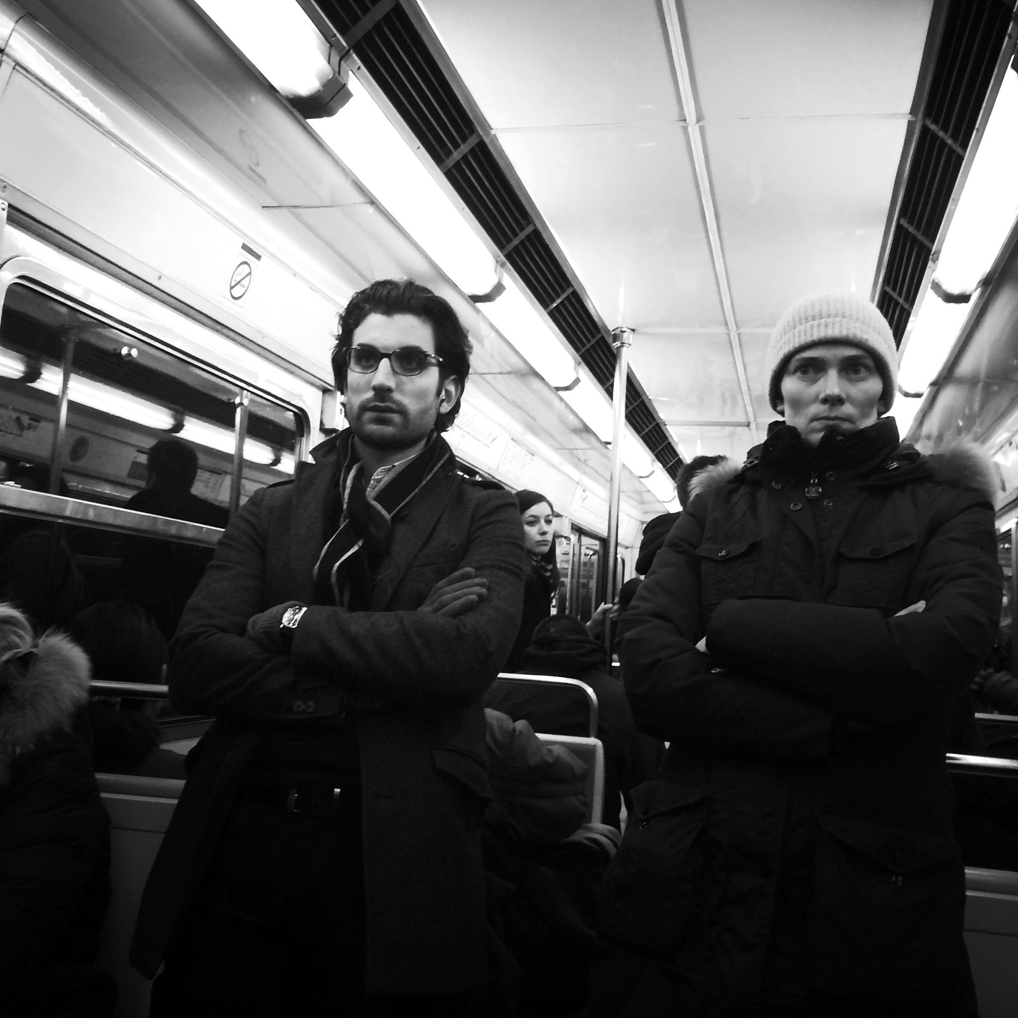 Folded arms on the metro by parisfind