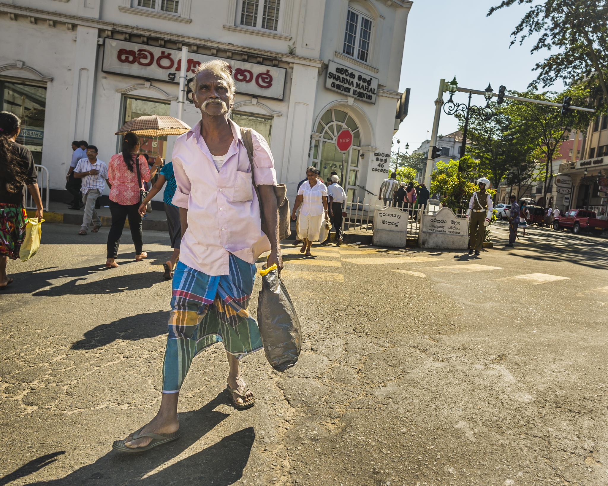 Not only Scots wear 'skirts'.;-) Typical Sarong worn in Sri Lanka. by Rafal Krzysiak