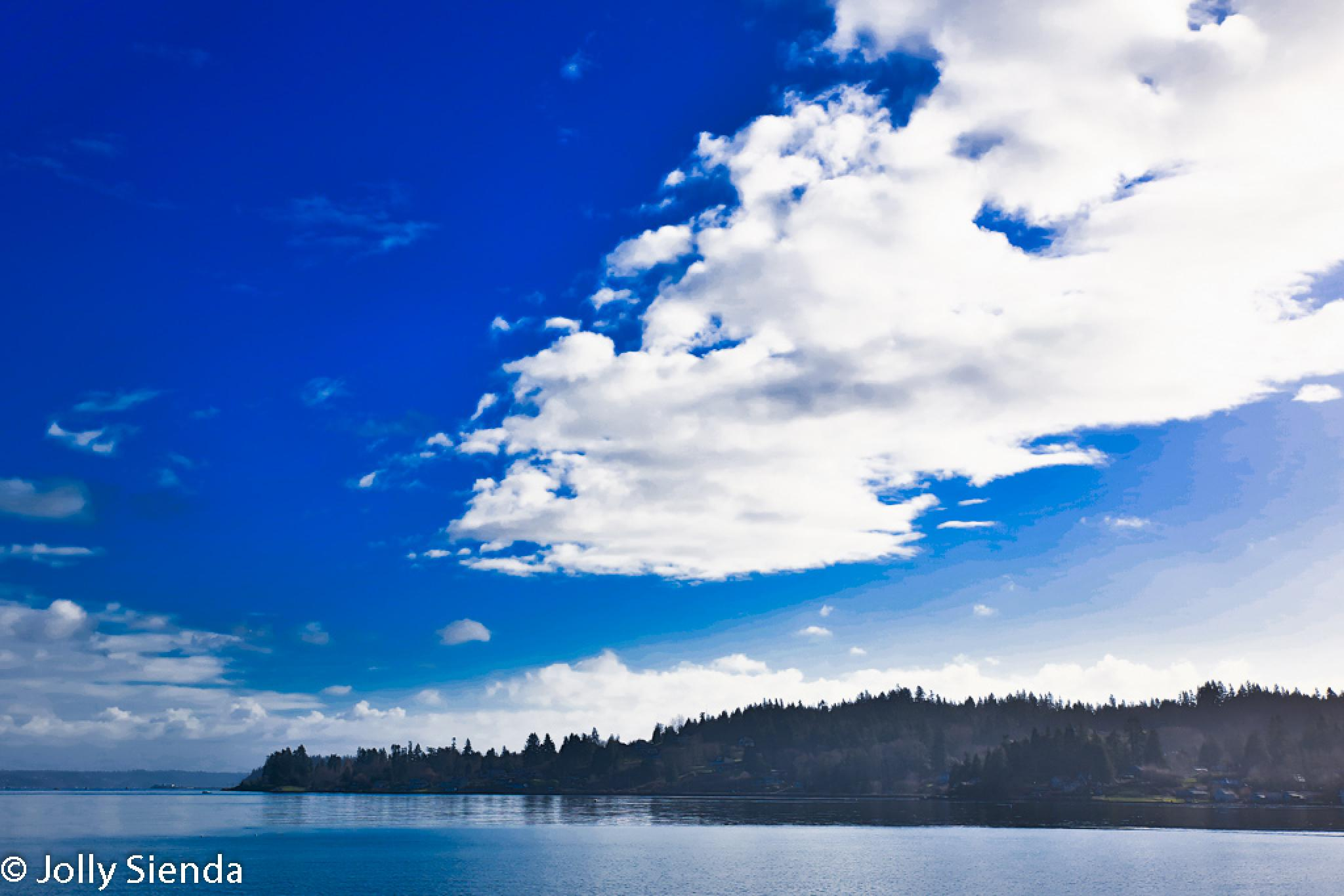 The deep blue sky over Puget Sound. by Jolly Sienda
