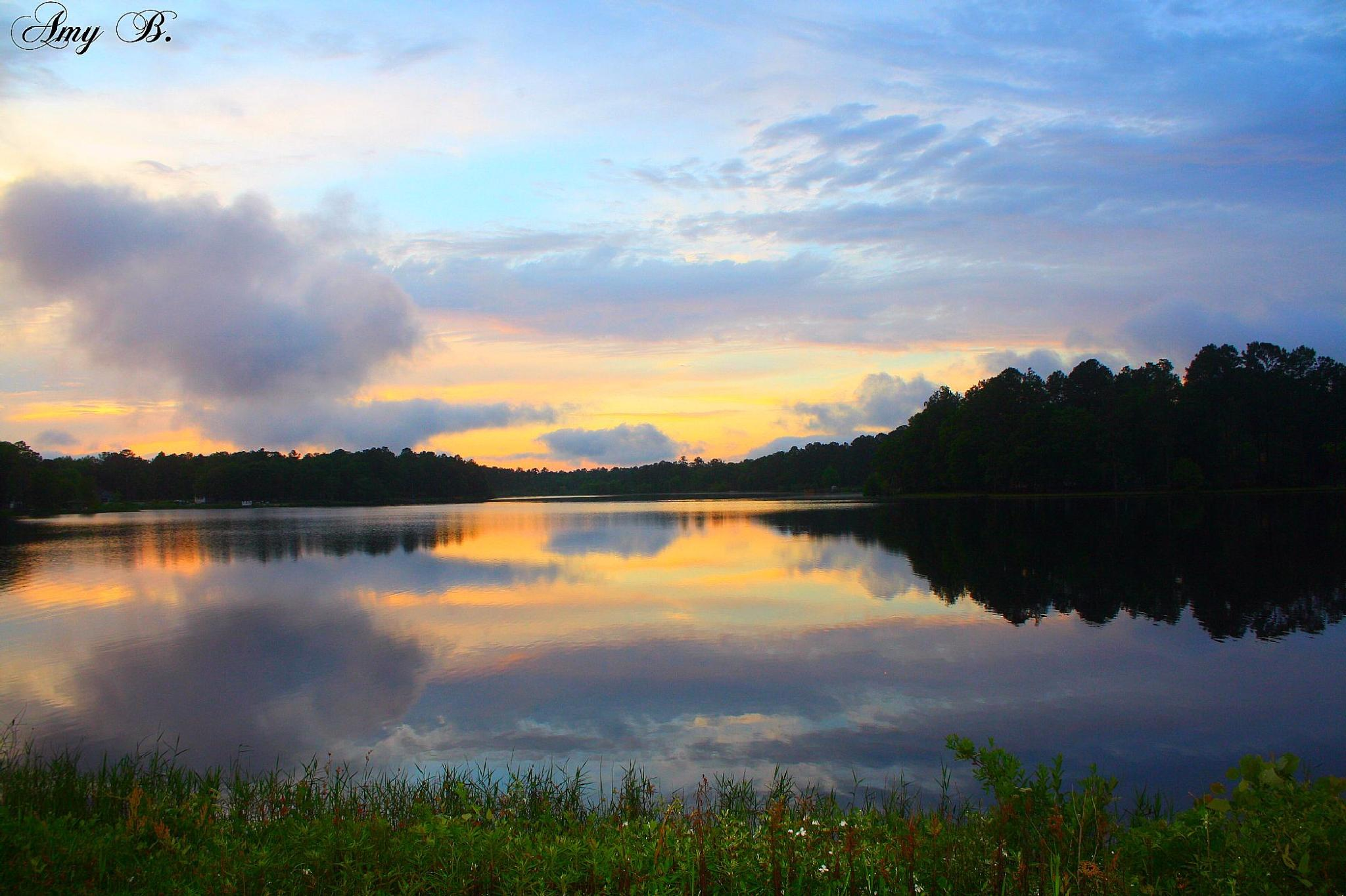 Blue and yellow sunset reflected in lake by amy.conger.9