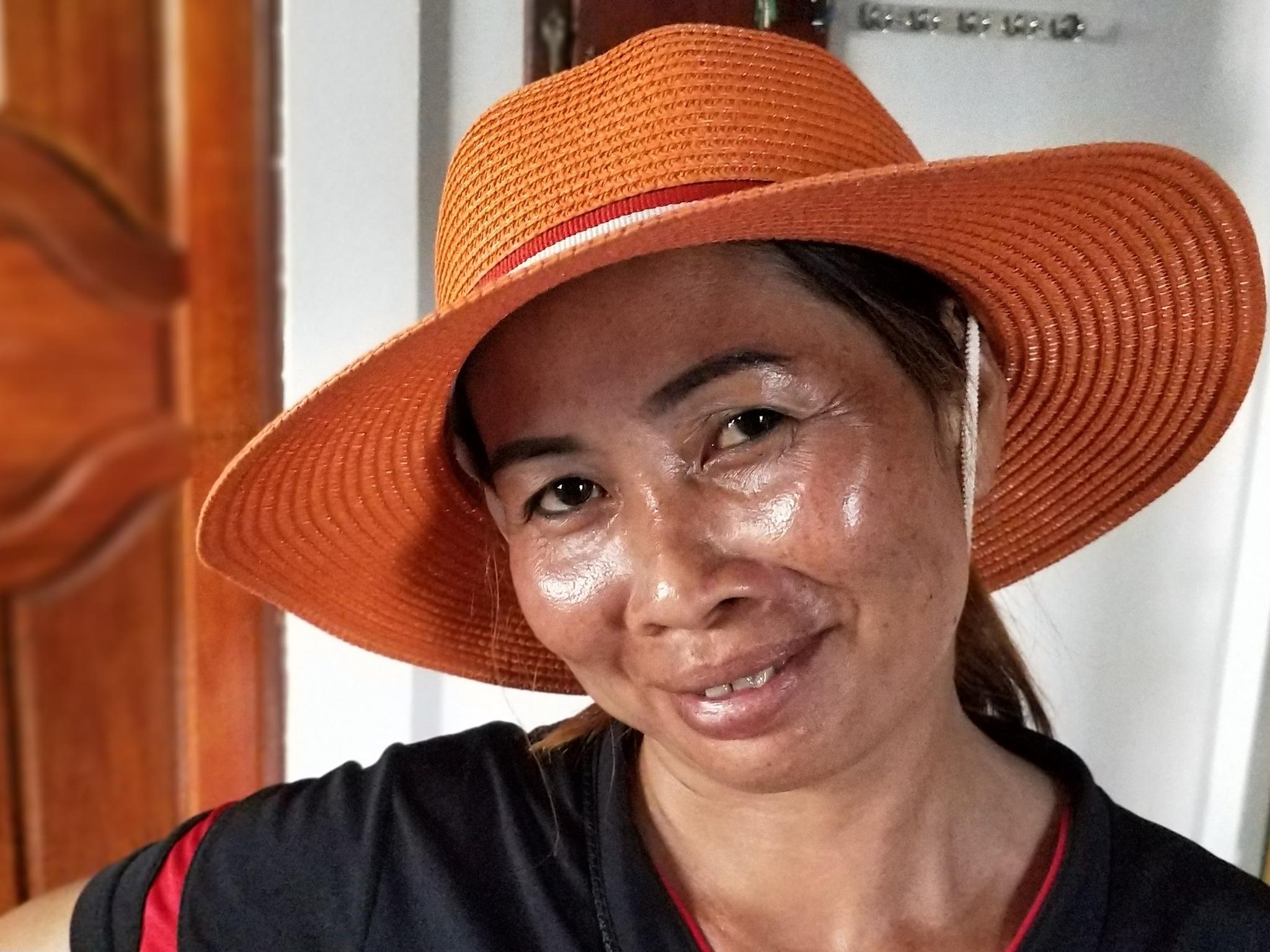 X027 Lady in orange hat 2 by Jeremy Holton