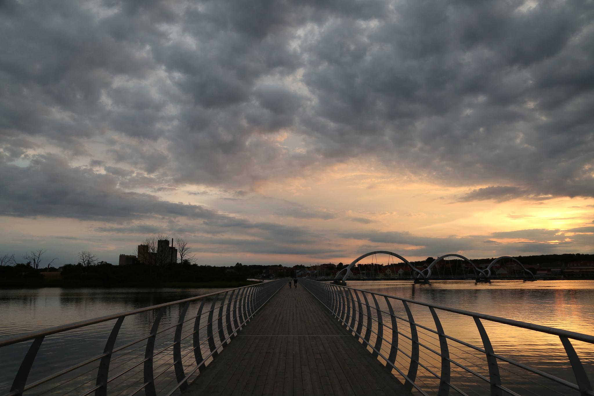 Cloudy sunset over favorite bridge by rejophoto