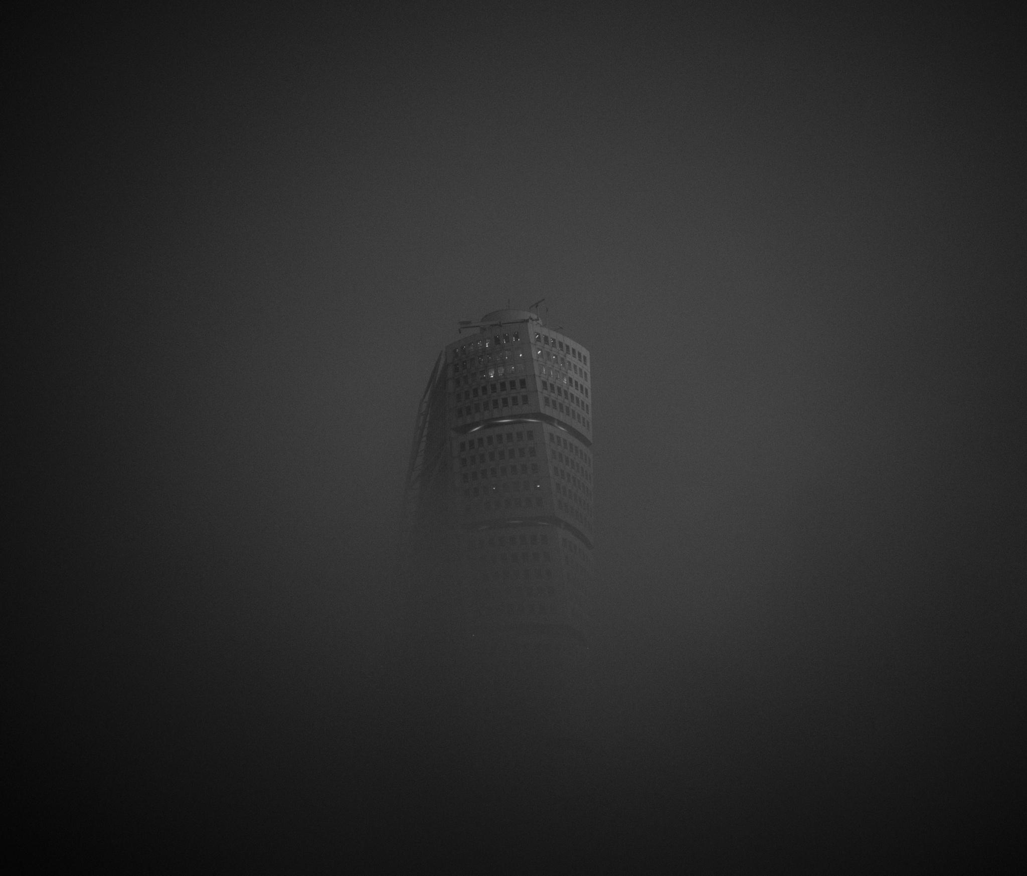 turning torso in fog  by lars-goran6