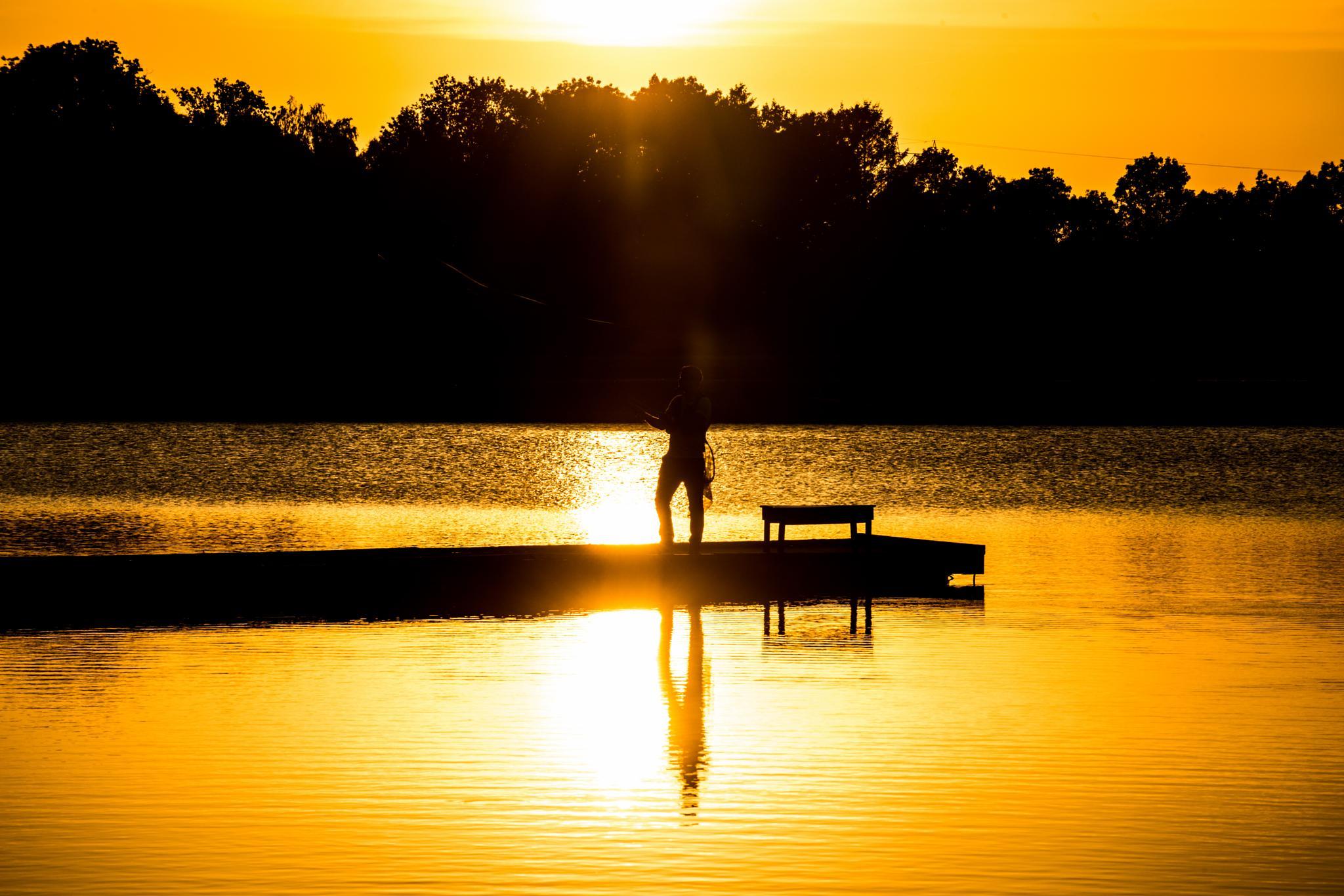 fisherman in sunset by lars-goran6
