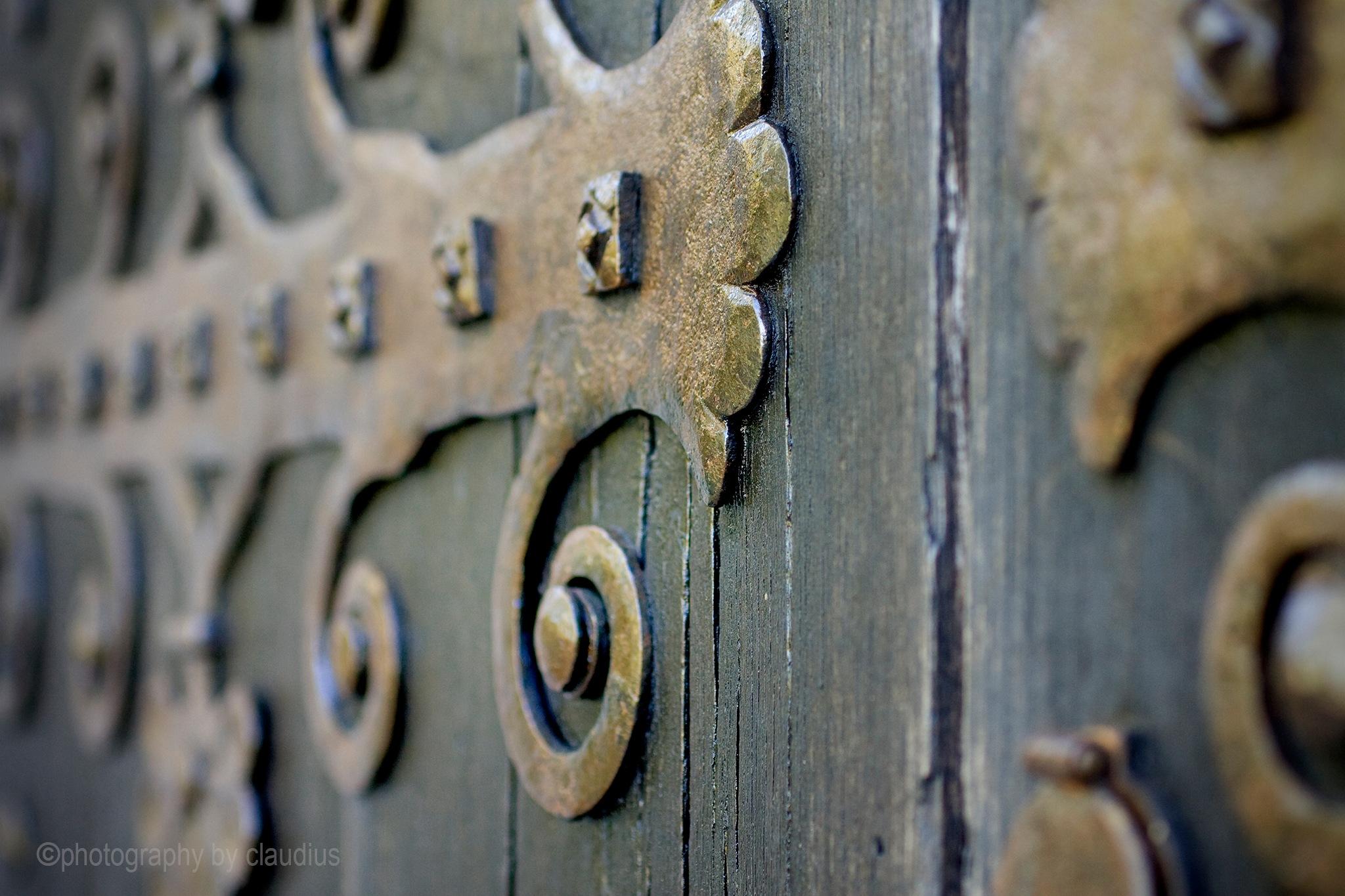 At the door... by Claudius Cazan