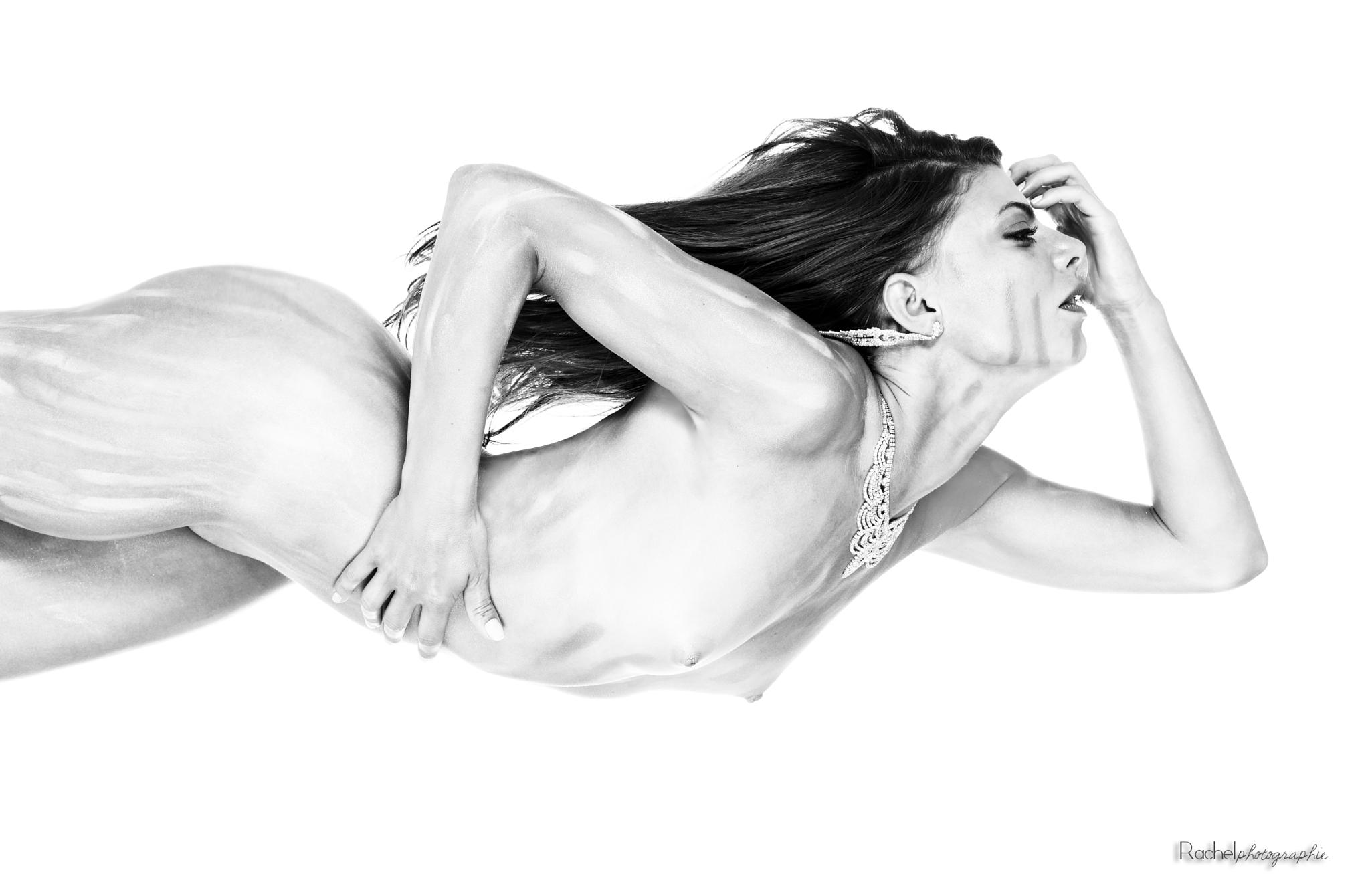 C. by Rachel M.