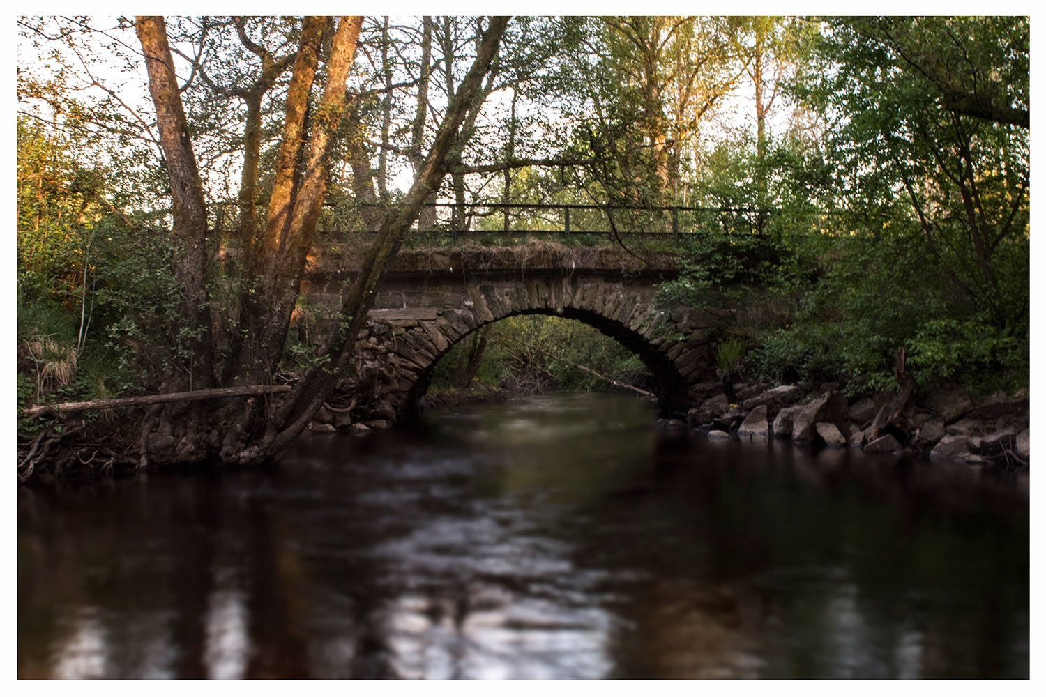 The old stone bridge at sunset by Linda Persson
