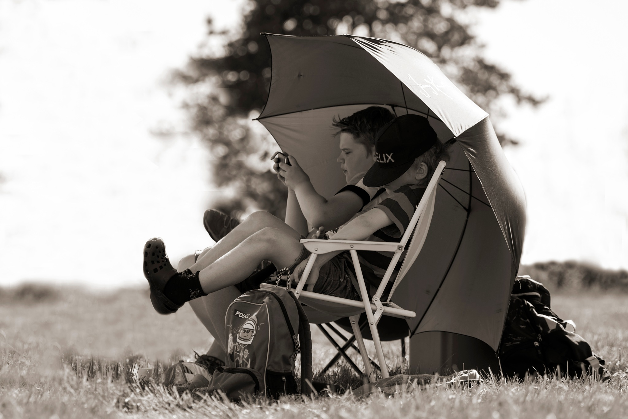 Boys and Umbrella by Linda Persson