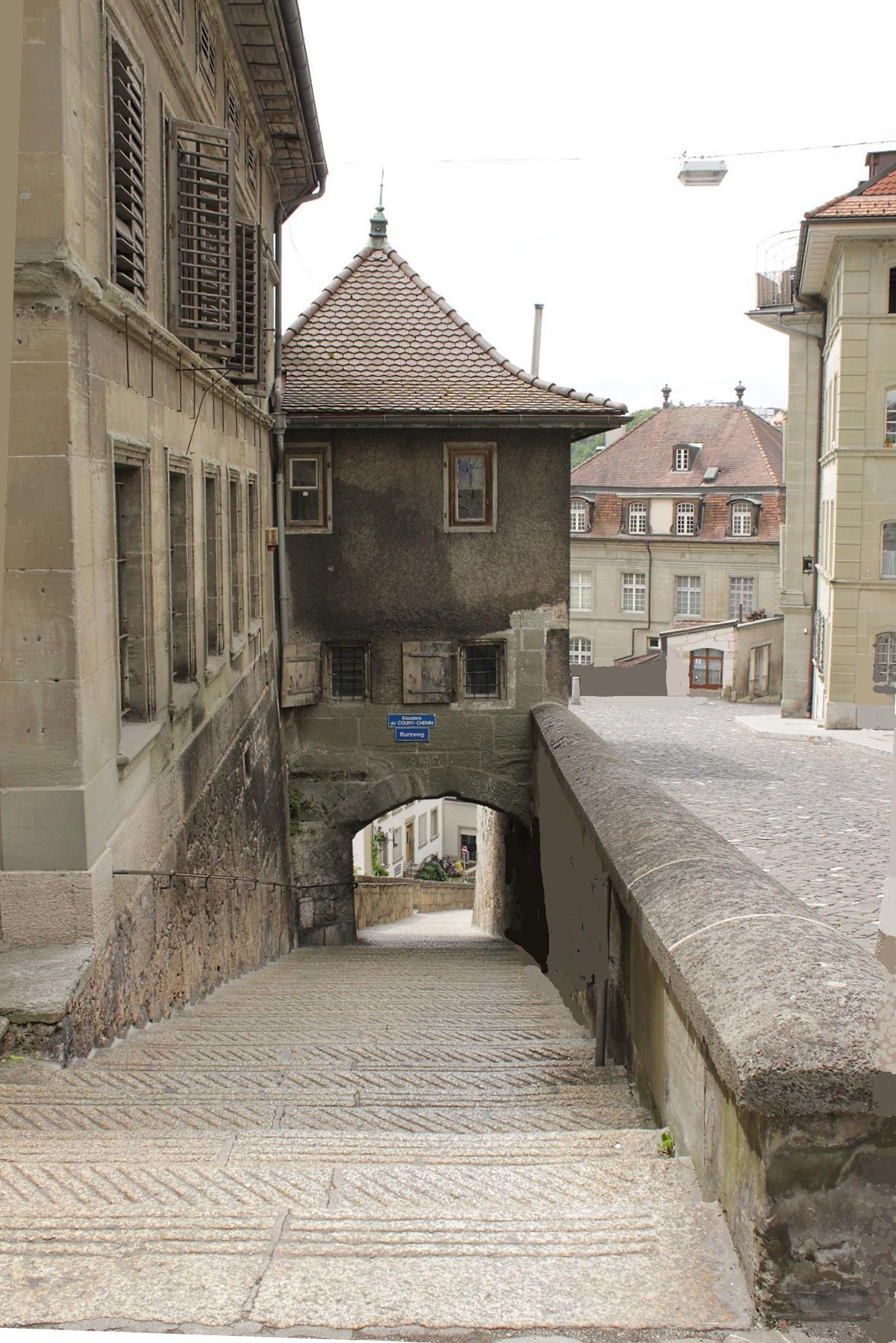 Stairs down to the lower town of Fribourg, Switzerland by Andre RAMSEYER