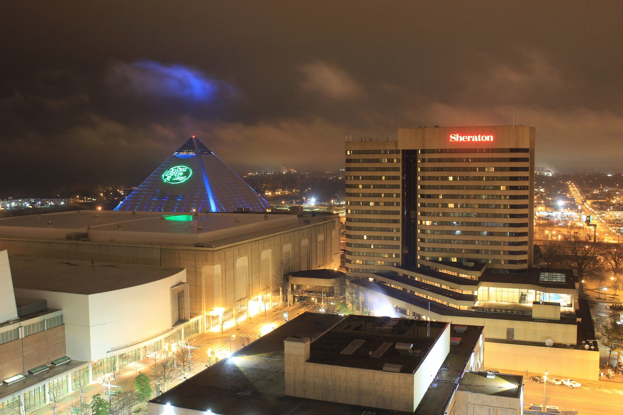 Photo in Cityscape #sheraton hotel #memphis #neon lights #city lights #pyramid #pyramid arena #urban exploration #blue #mist