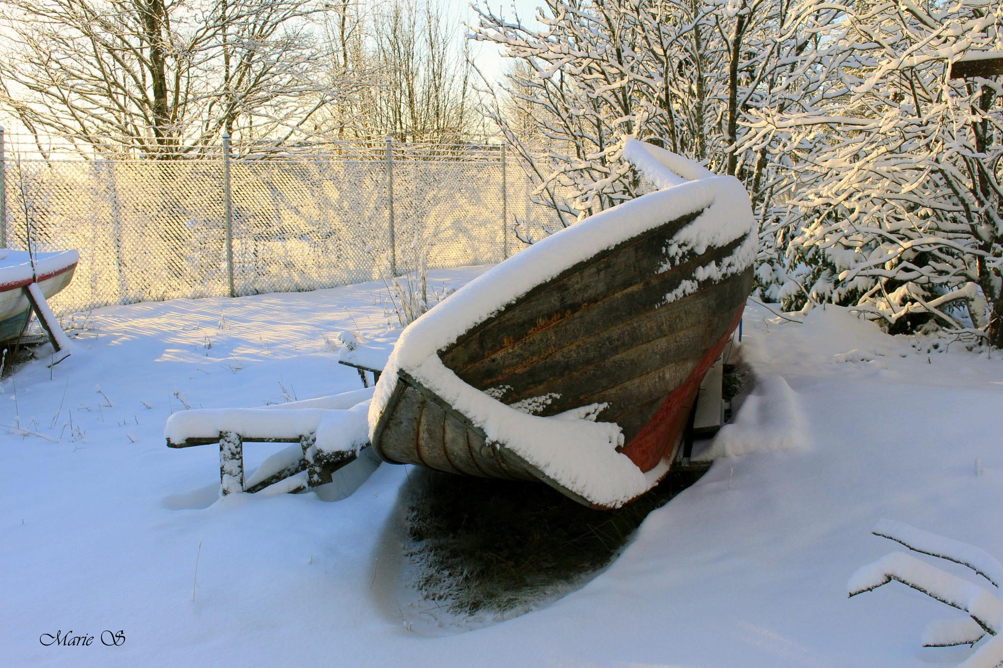 Boat on land in winter by Marie Stjärnborg