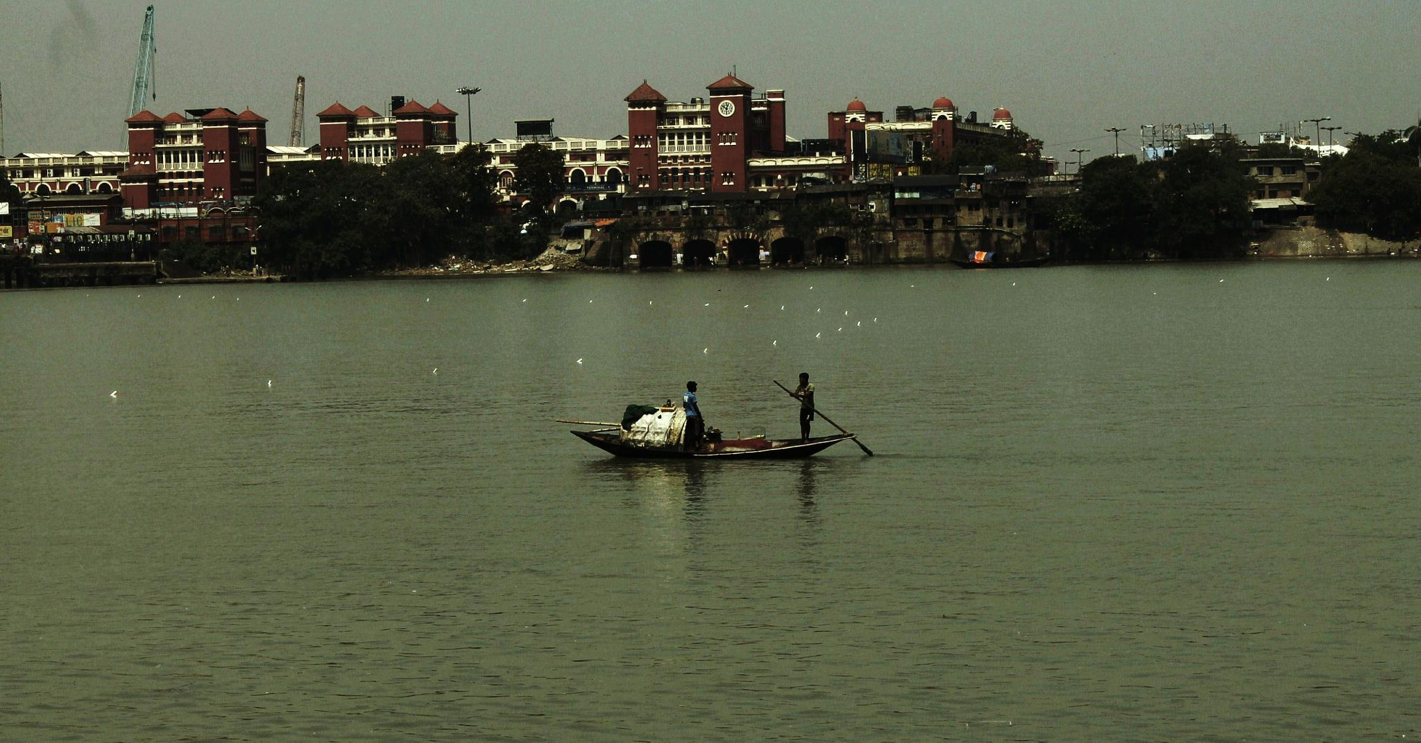 River Ganges with enigmatic Howrah Station in the background by subhagatadey