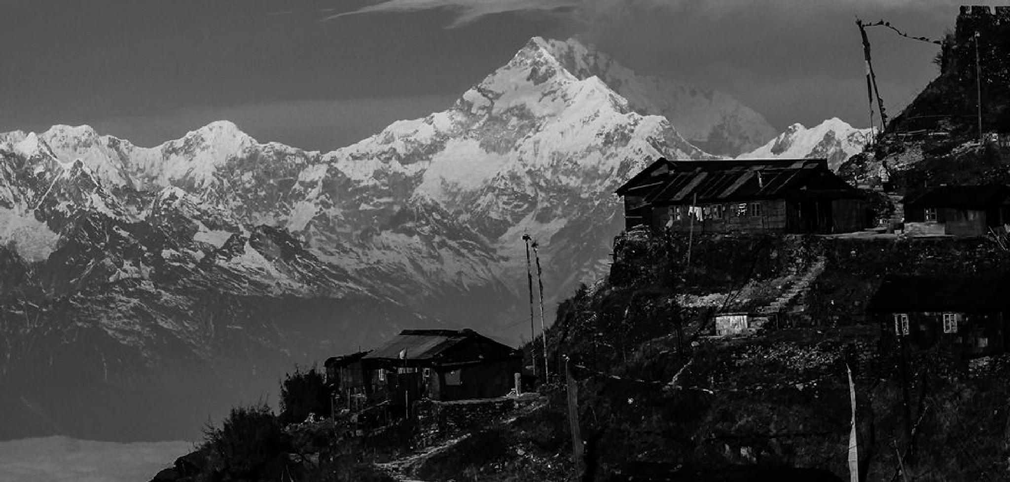 A Sleepy Village with Mt Kanchenjonga in the background by subhagatadey