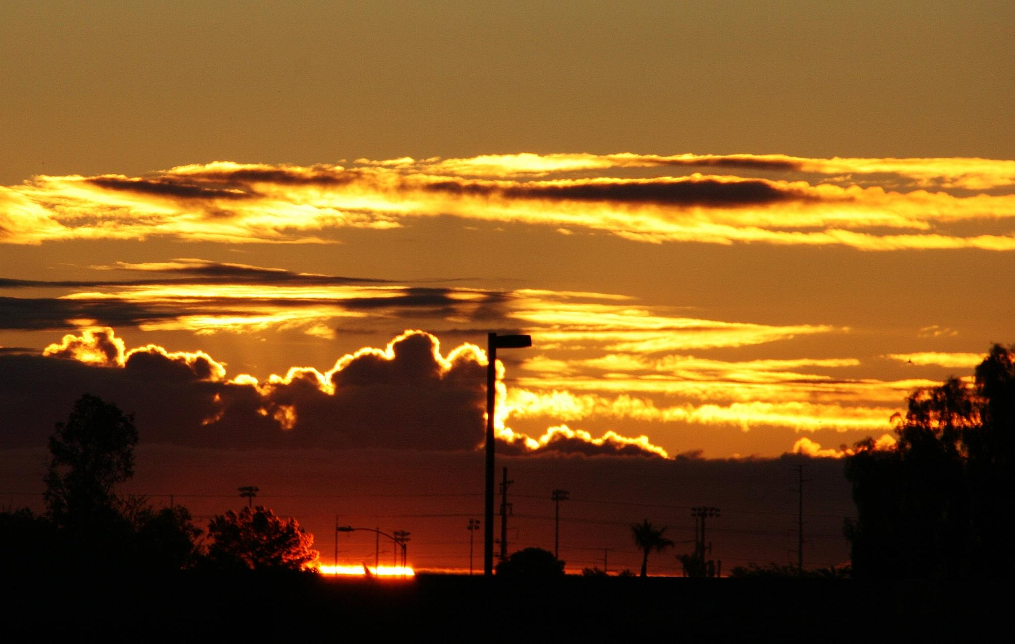 Cloudy Sunrise by kathy.larsen