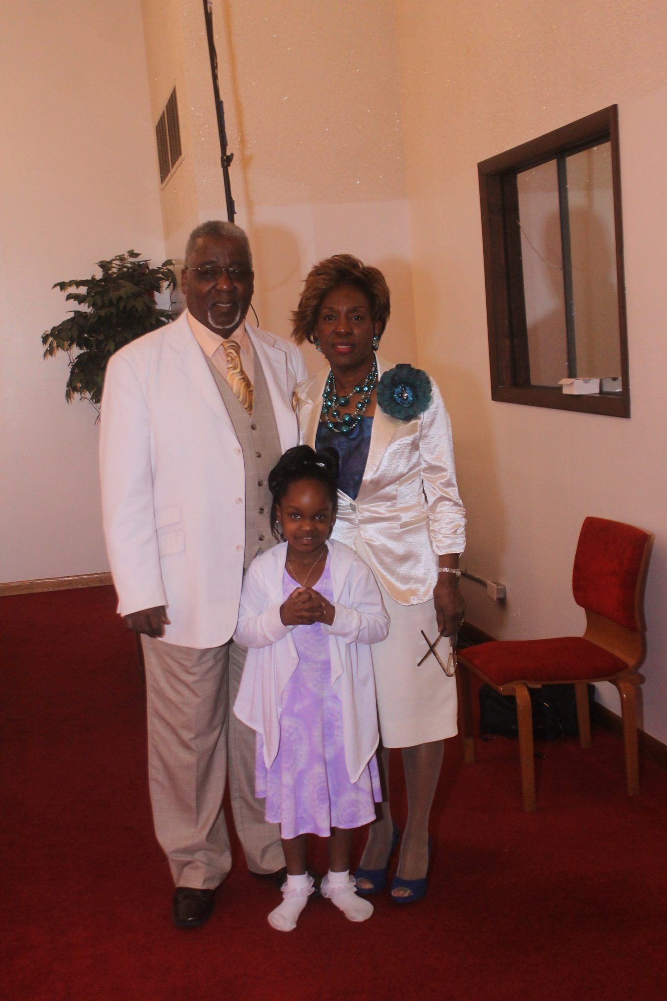 Pastor, First Lady And Granddaughter by Robert Burrell