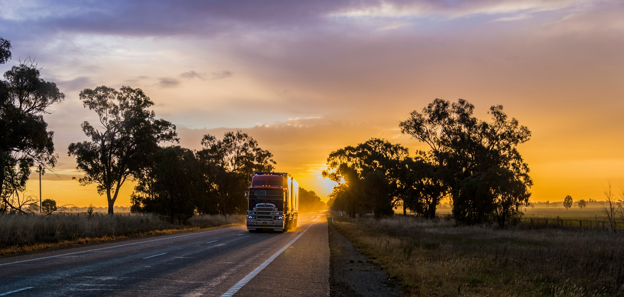 Sun setting on the Highway by Taylor Allcock