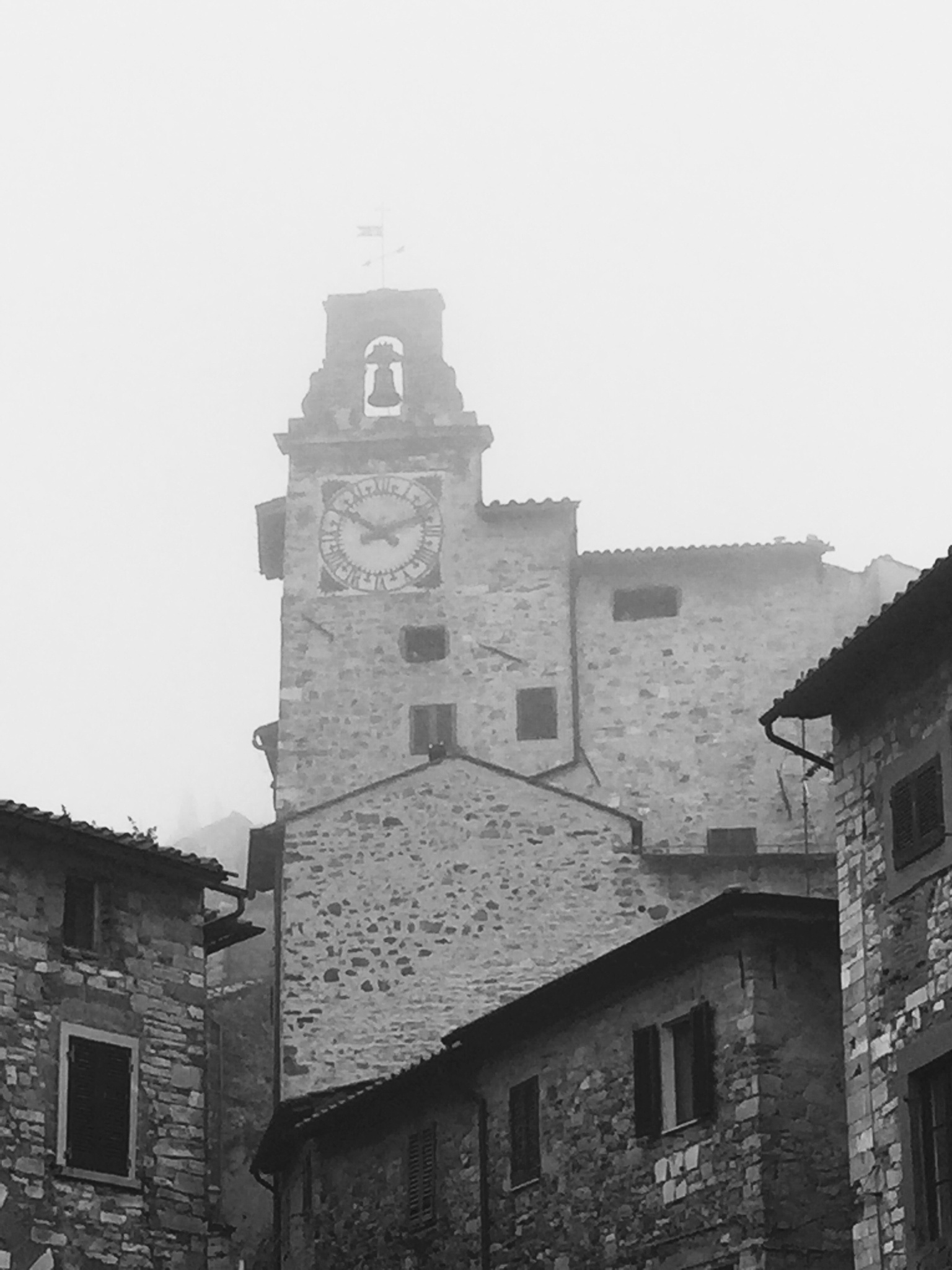 The bells tower in a foggy day by giorgiomorrone