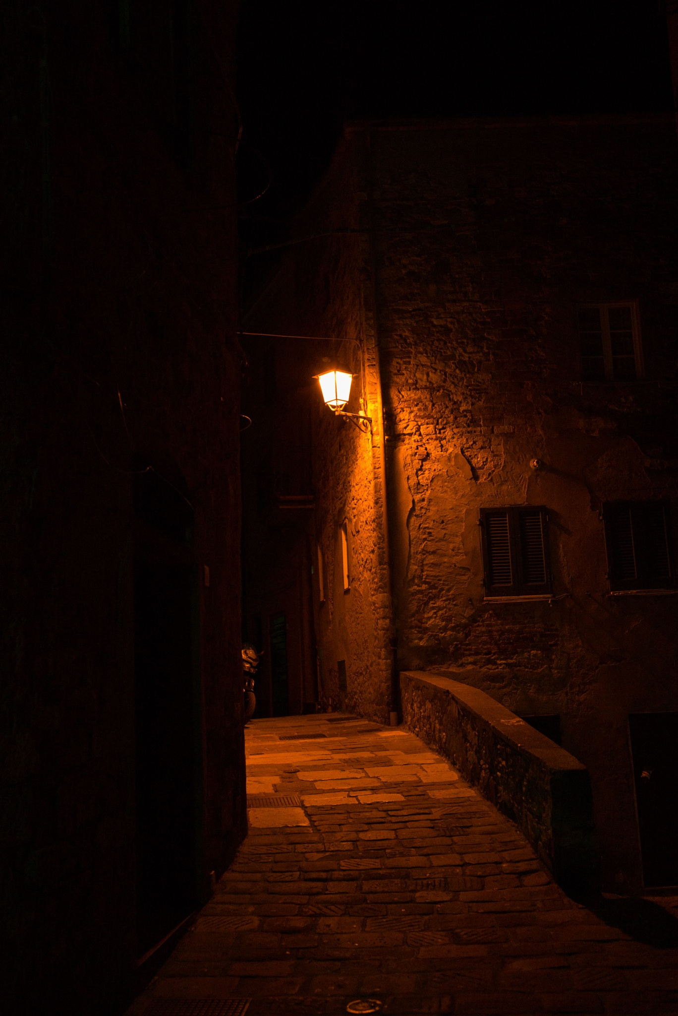 Village alley at night by giorgiomorrone