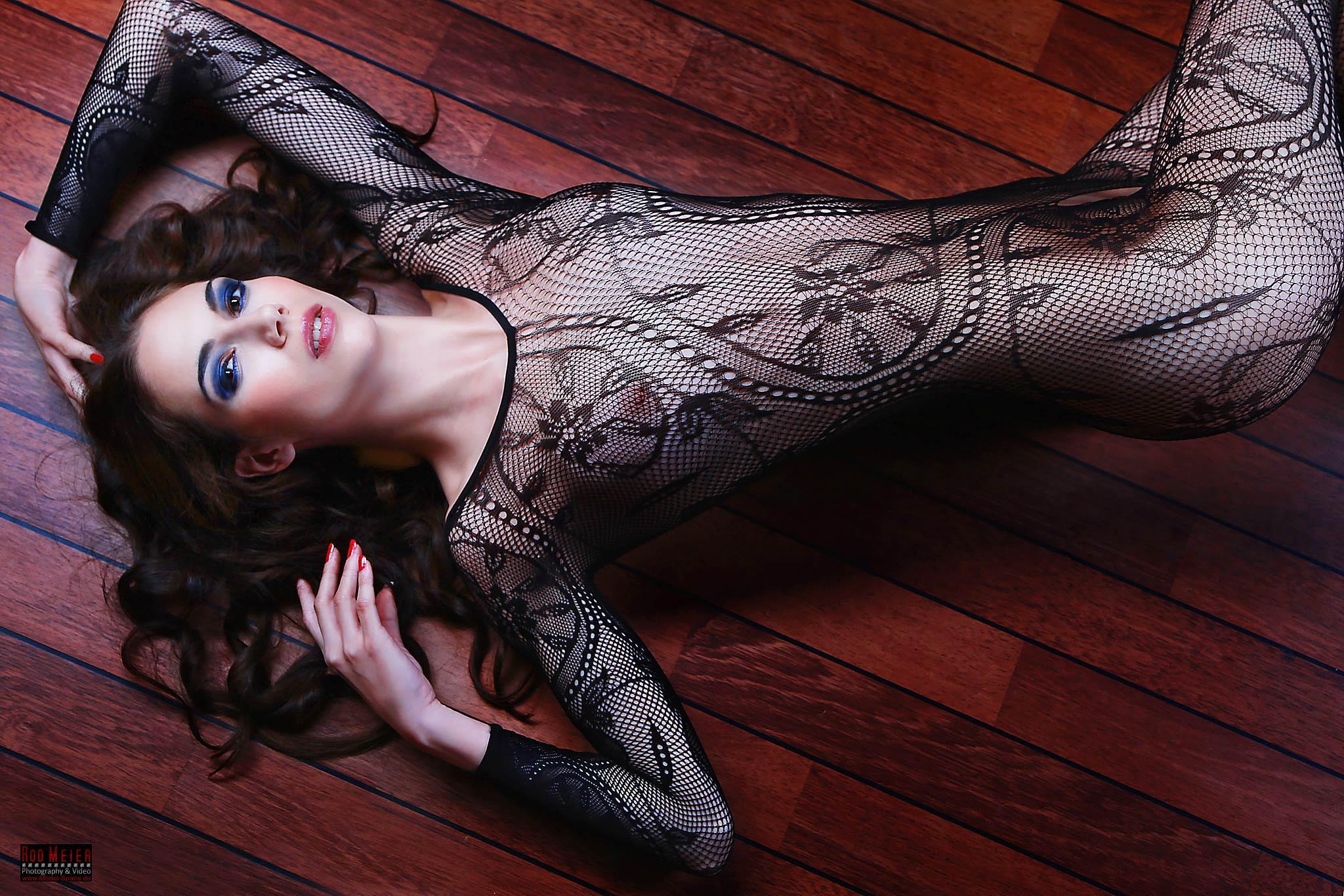 Beauty in Fishnet Catsuit by Rod Meier - Photography