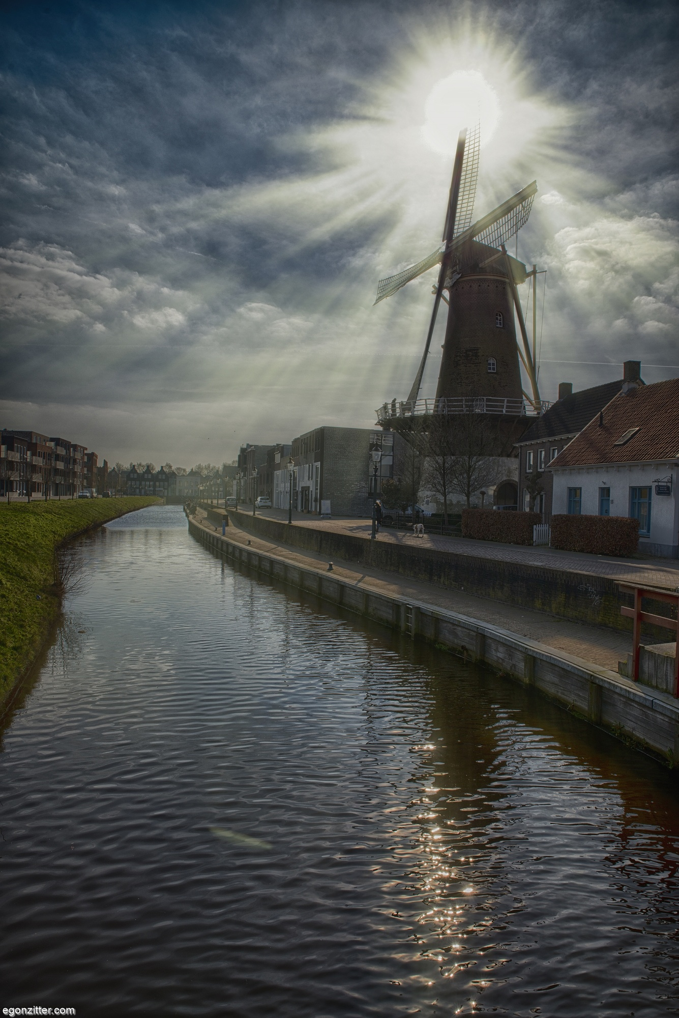 Windmill along the river by egonzitter