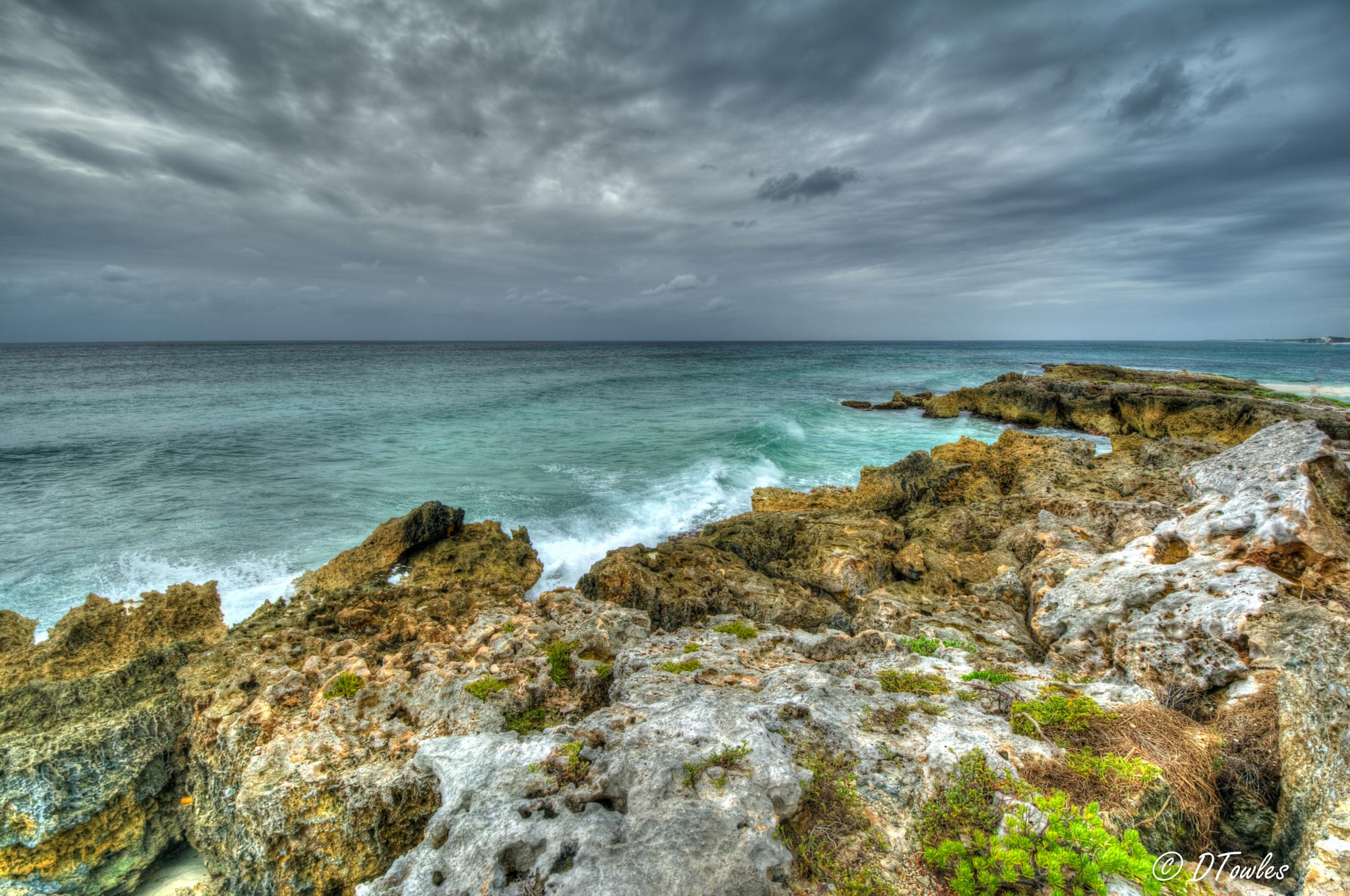 Photo in Sea and Sand #mexico #cozumel #sea #beach #rock #clouds #caribbean
